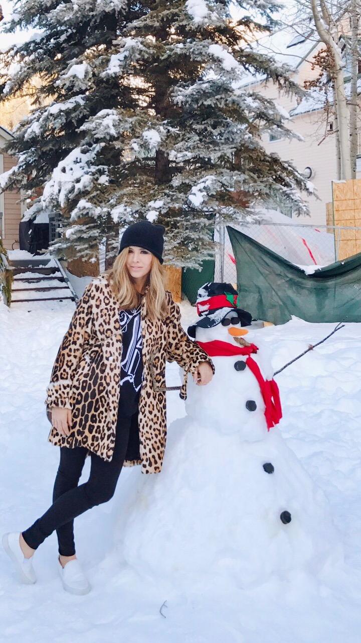 Kelley Fertitta leaning on a snowman