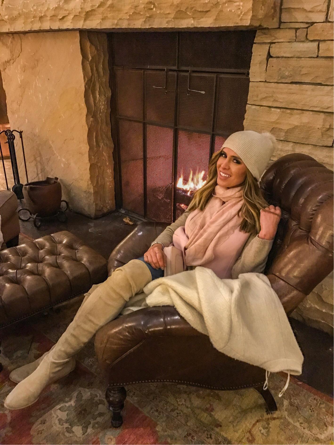 Kelley Fertitta bundled up fireside in Telluride Colorado
