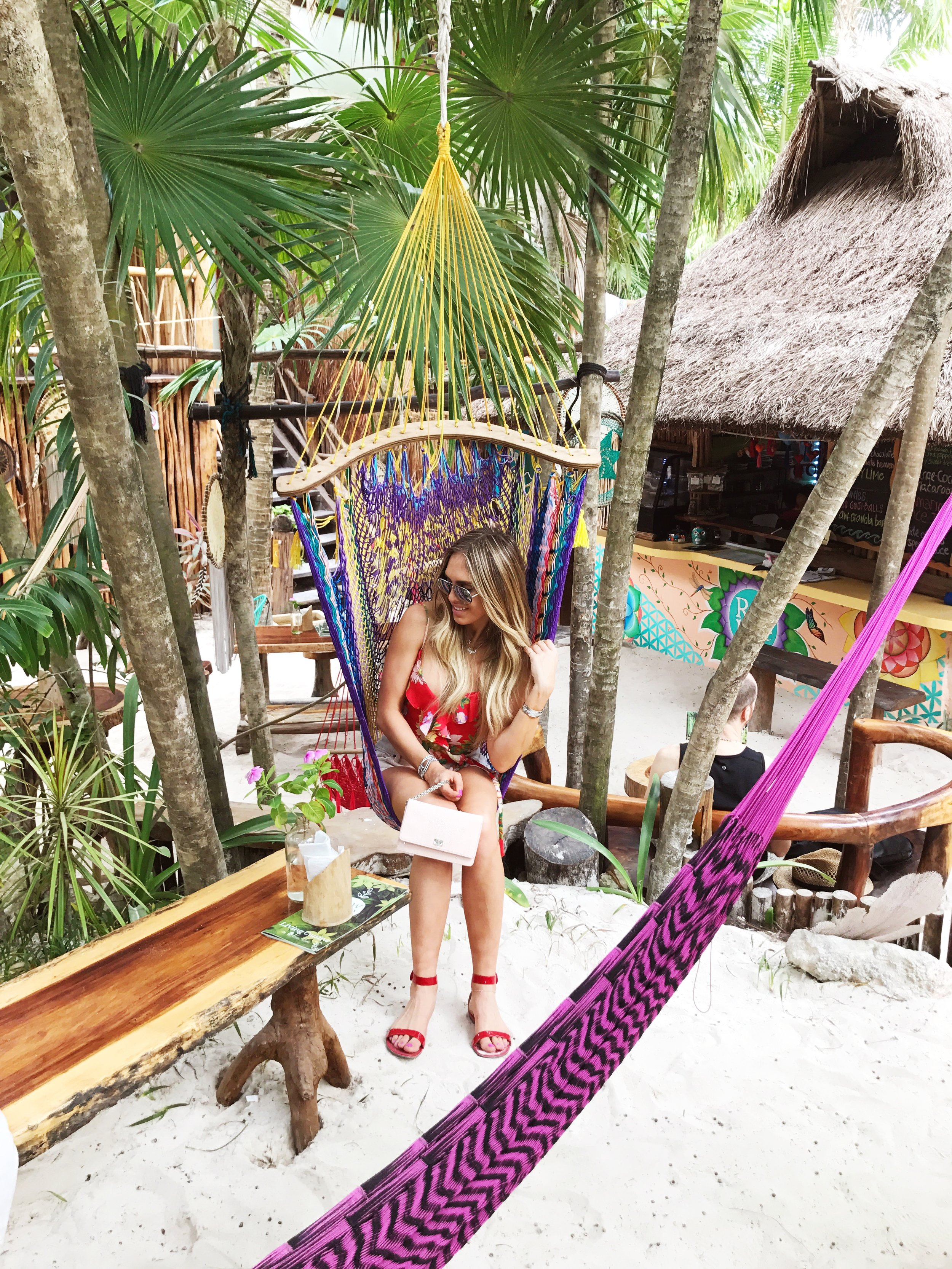 Relaxing in a hanging chair on the beach in Tulum Mexico