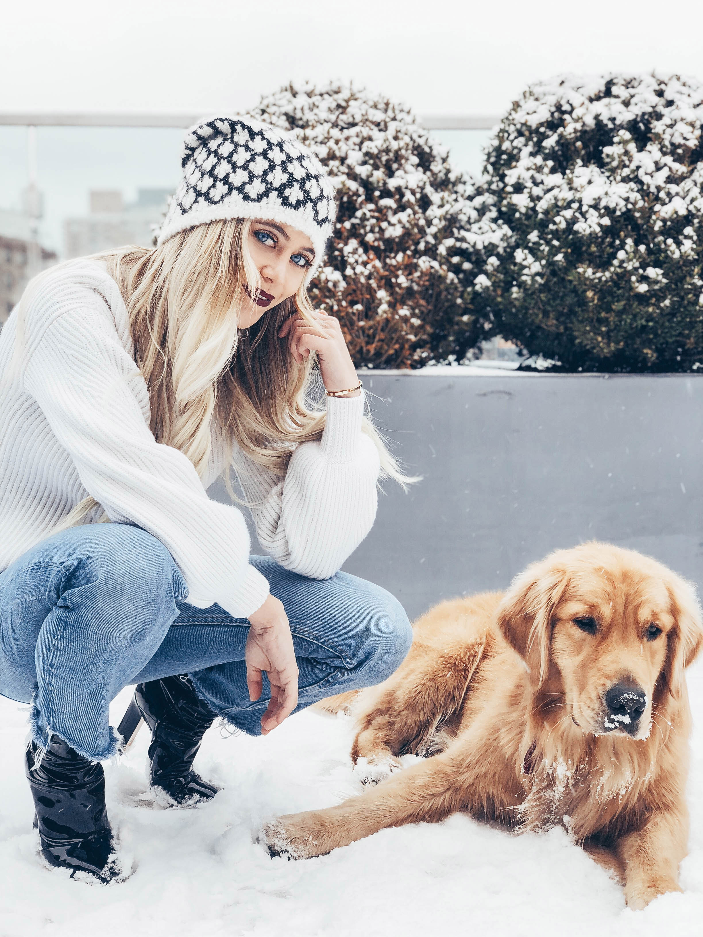 Victoria plaing in the snow with her pup