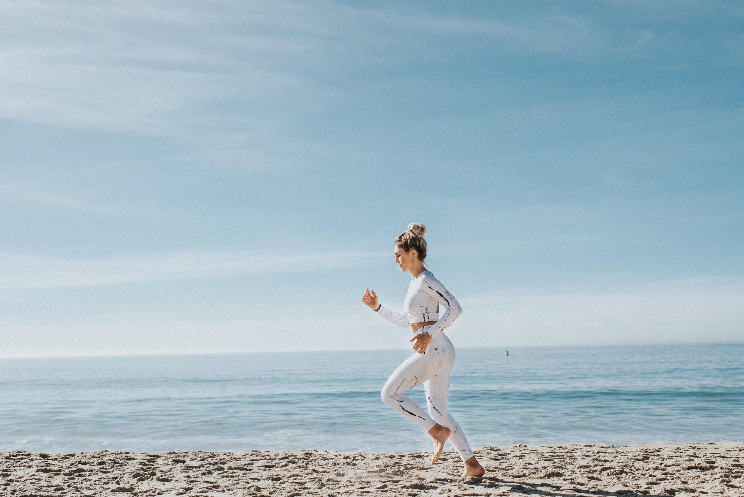 Running in the sand in Laguna Beach