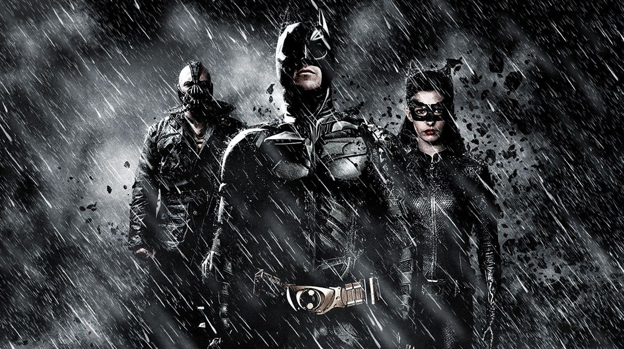Batman returns, played by Christian Bale, flanked by Anne Hathaway and Tom Hardy