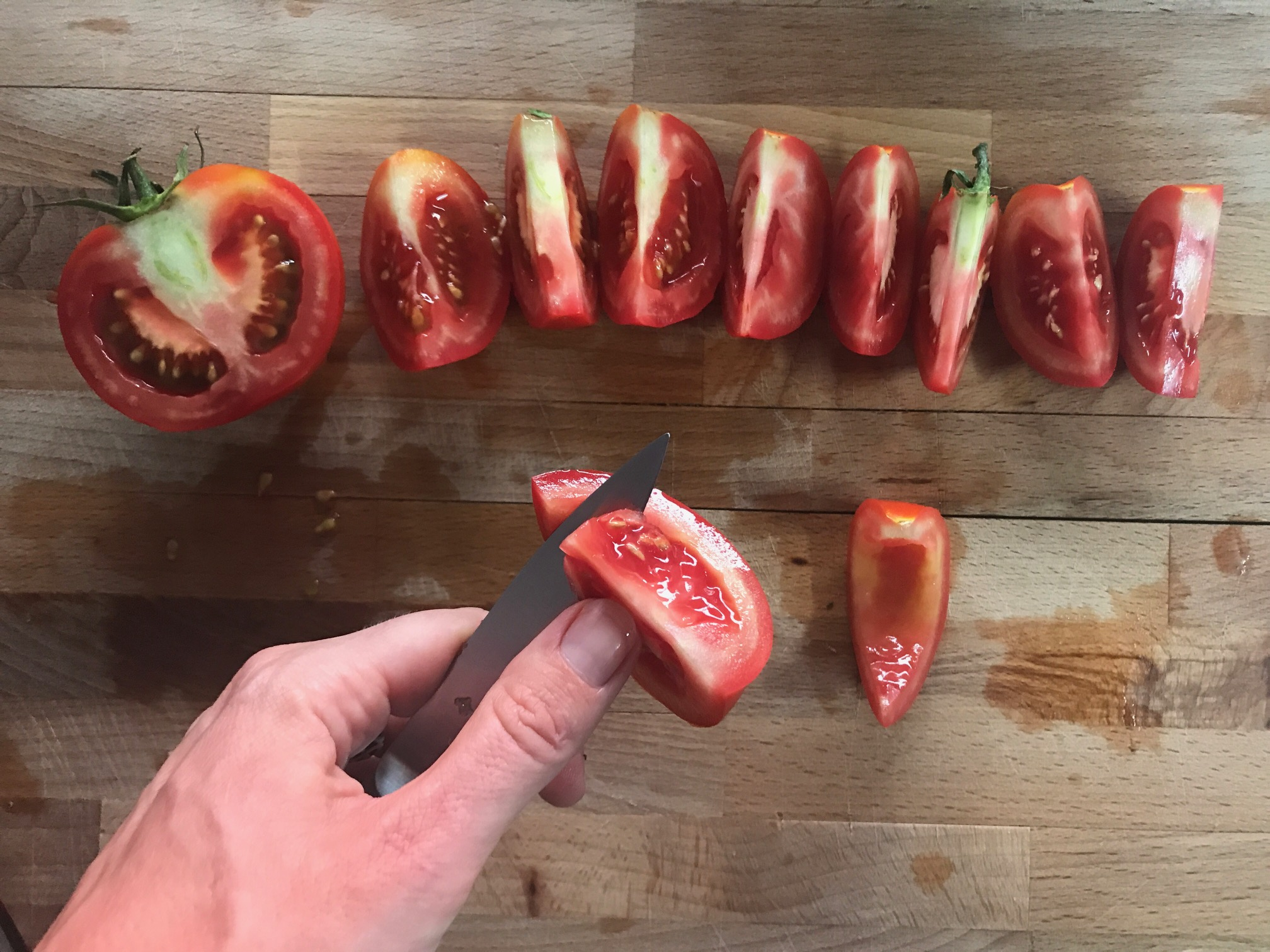 De-seeding tomatoes with a paring knife
