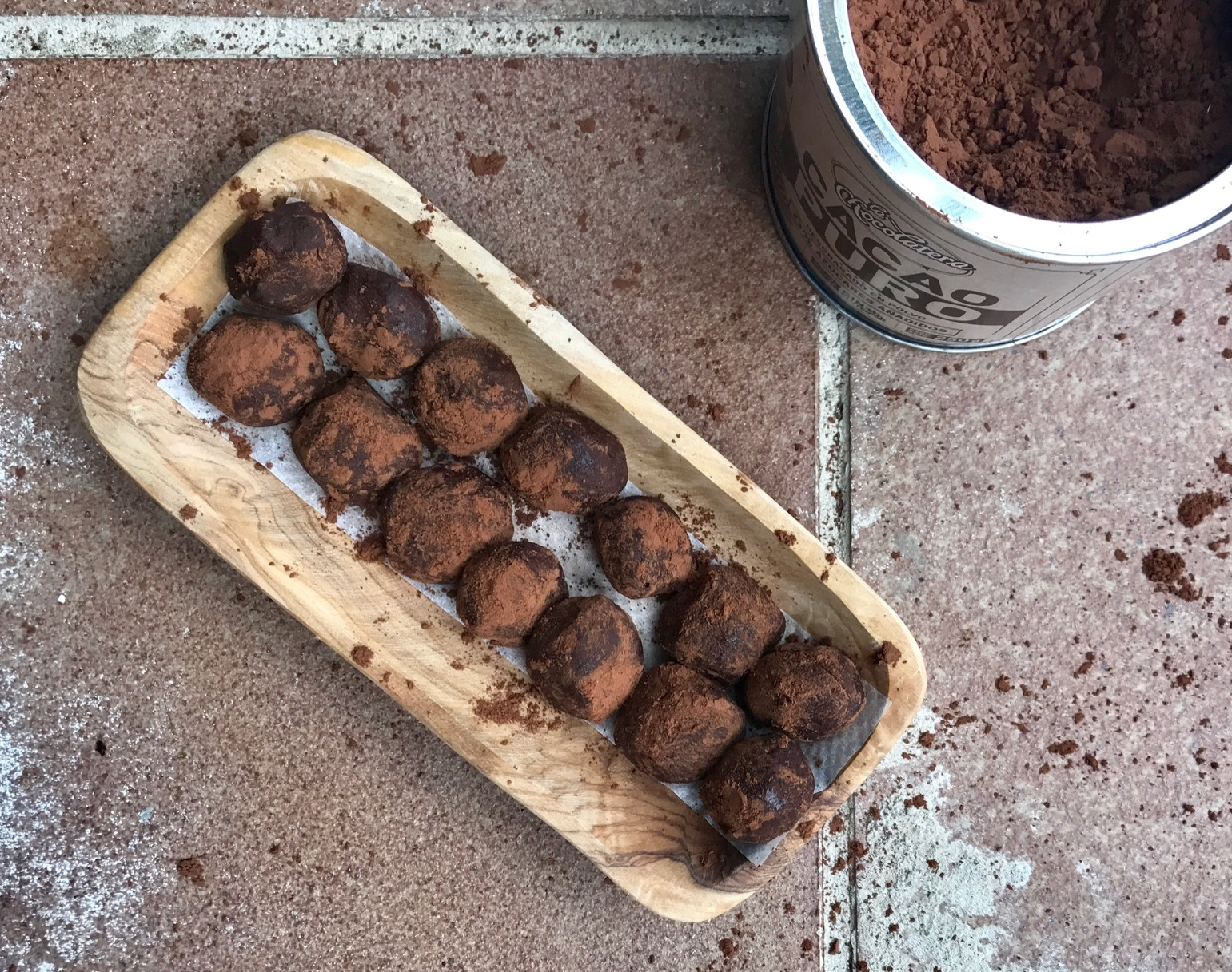 Gooey Dark Chocolate Caramel Truffles look great  with a messy dusting of cocoa powder