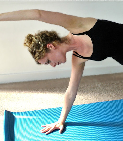 Emily Hayward, Pilates & Yoga Instructor practicing at Bristol Yoga Center.