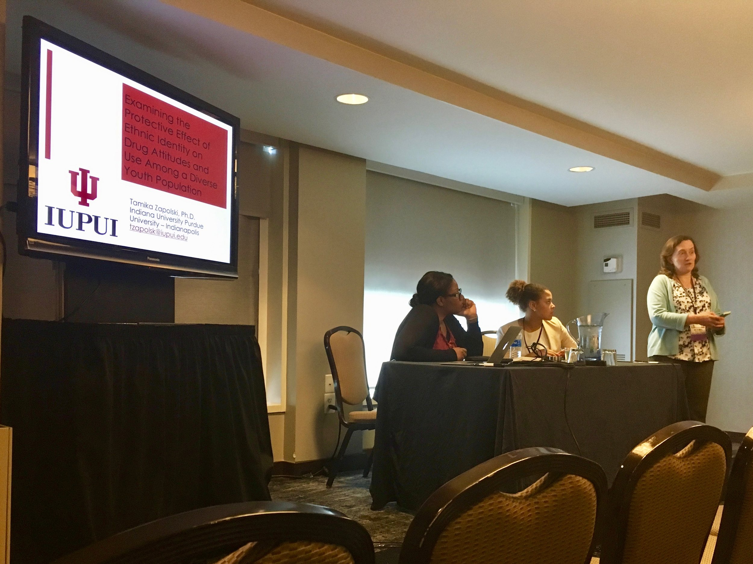 Dr. Zapolski and Devin present their papers at a symposium concerning racial/ethnic differences in predictors of substance use during adolescence.