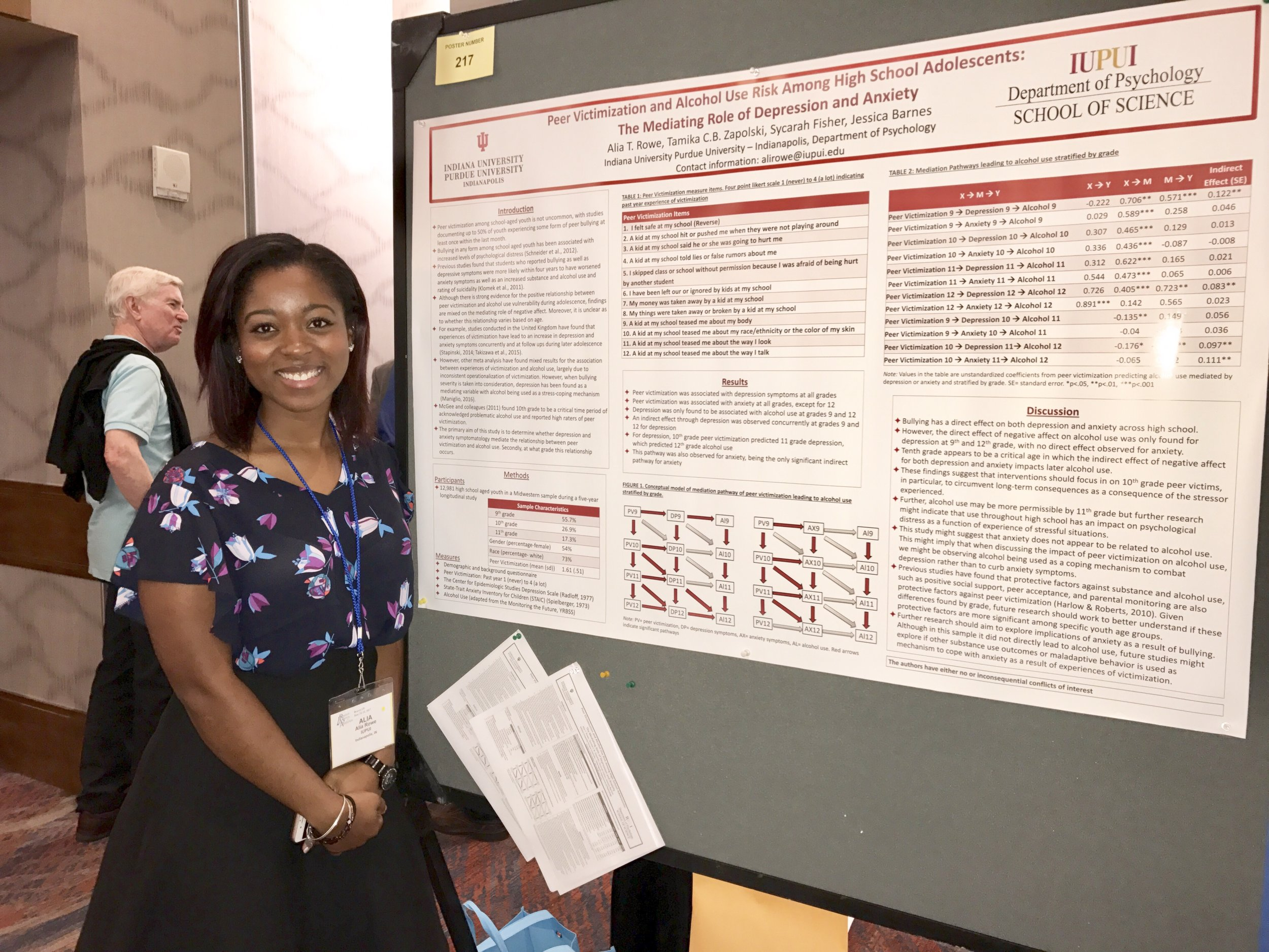 Alia Rowe and her poster at RSA.
