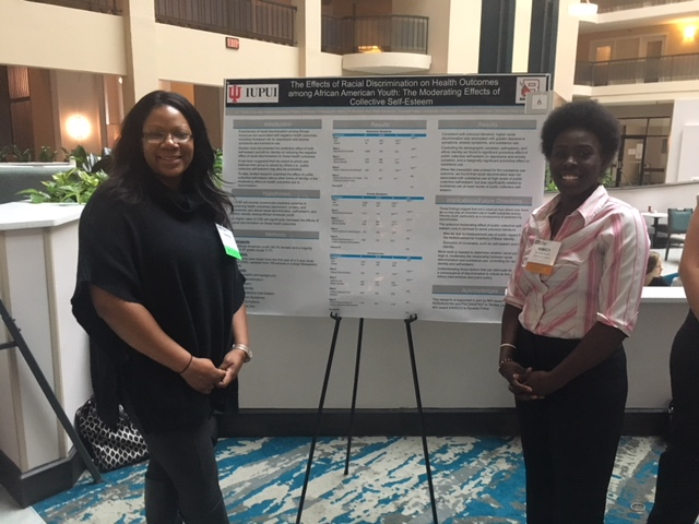 Dr. Zapolski and Marcy Beutlich, our research intern from Ball State University pose with Marcy's poster
