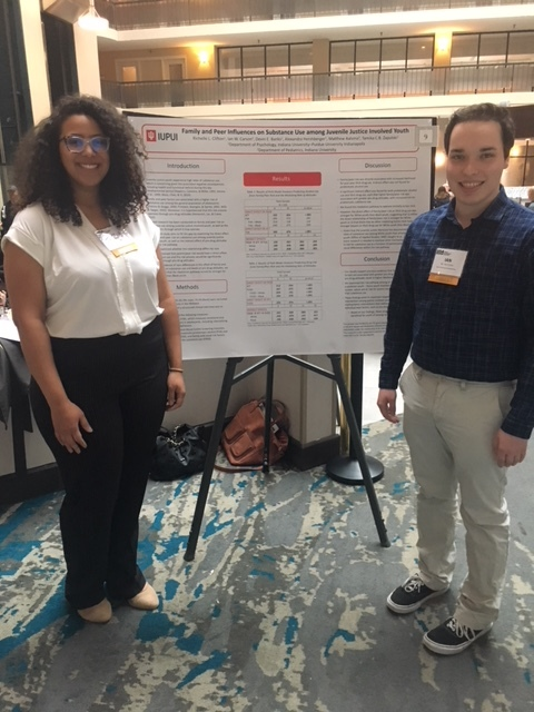 First year graduate student, Richelle Clifton, and undergraduate student, Ian Carson, pose with their poster