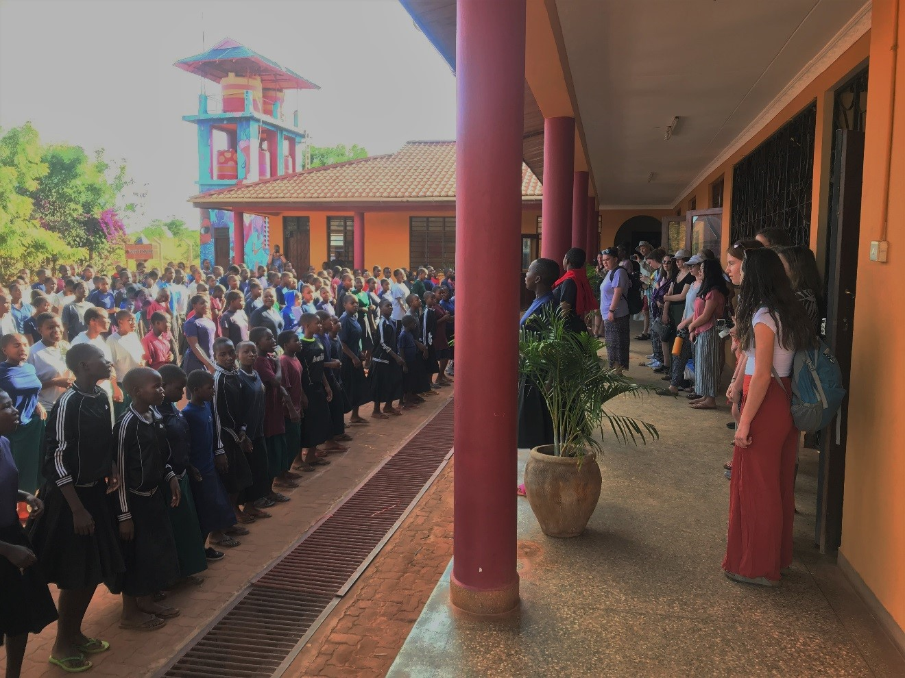 SEGA students sing the school welcome song to visitors during morning assembly.