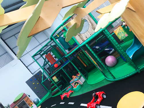 The two tier junior play structure full of games, toys, soft obstacles and a mini climbing wall.