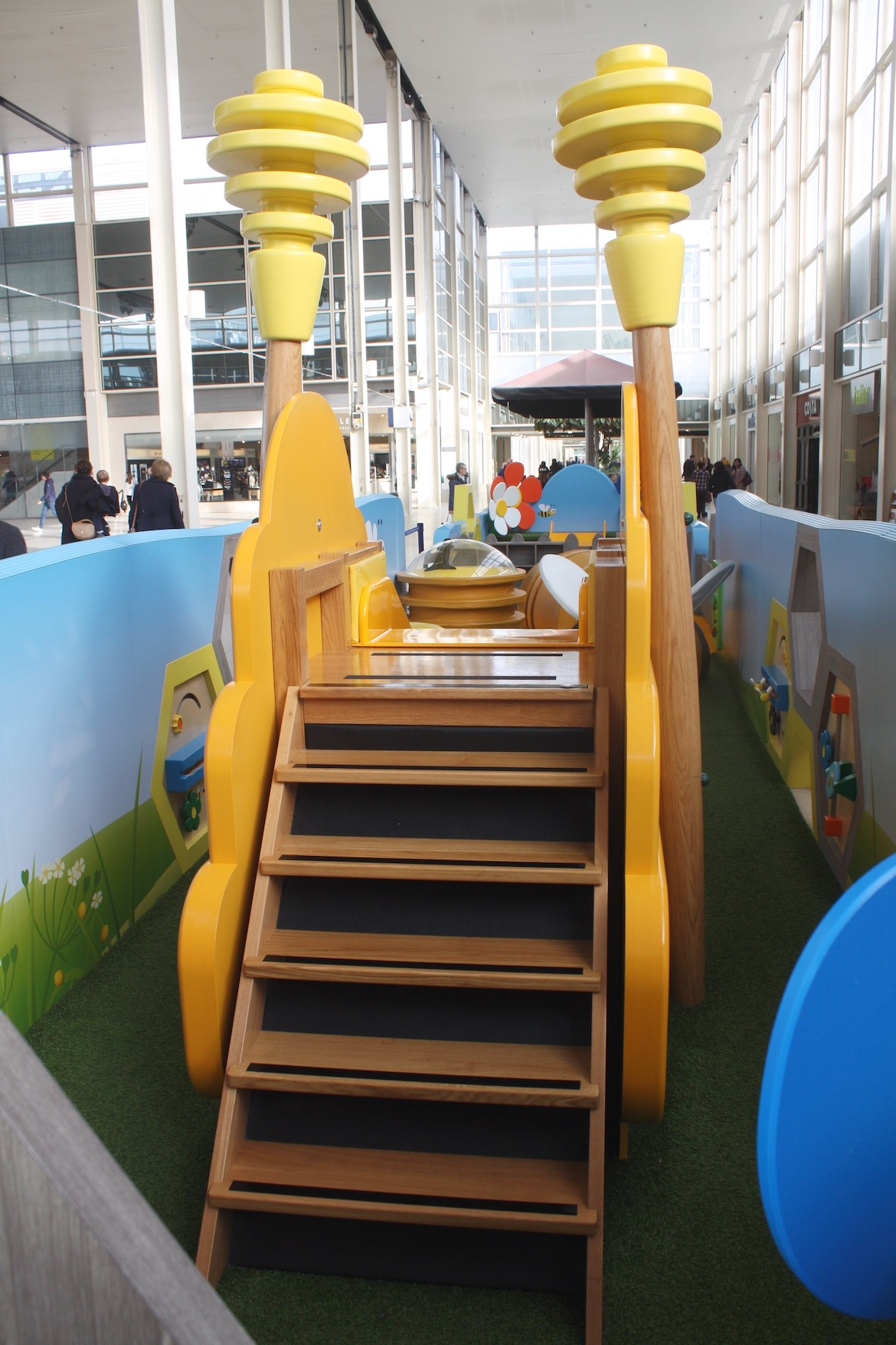 The hand-built anti-slip staircase to the slide is surrounded by 2 giant honey dippers.