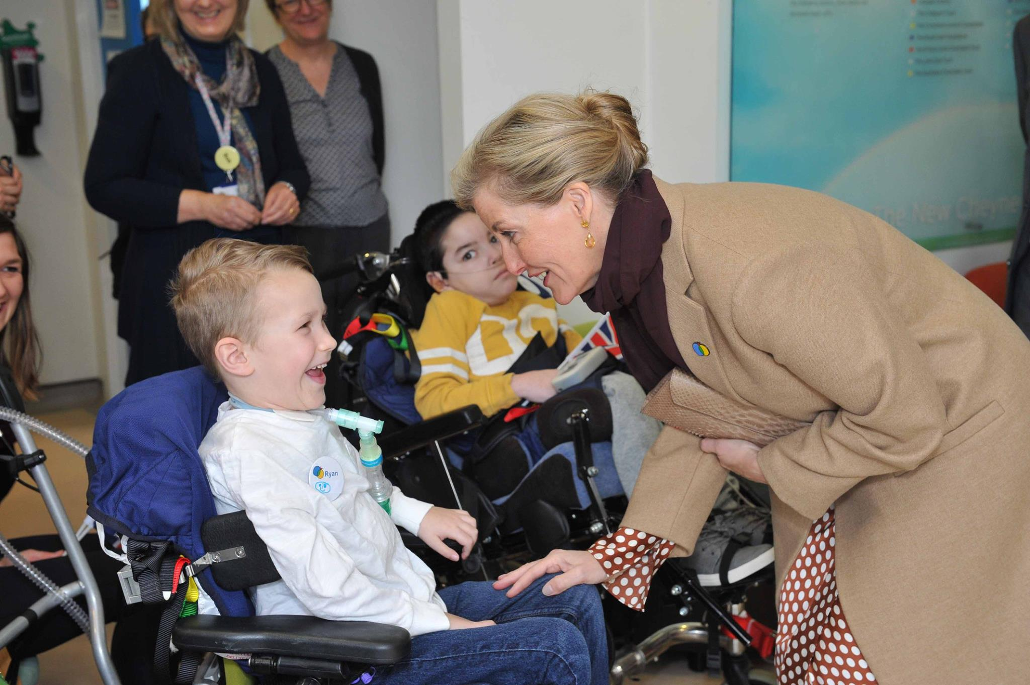 HRH The Countess of Wessex meets a child at the rehabilitation centre.