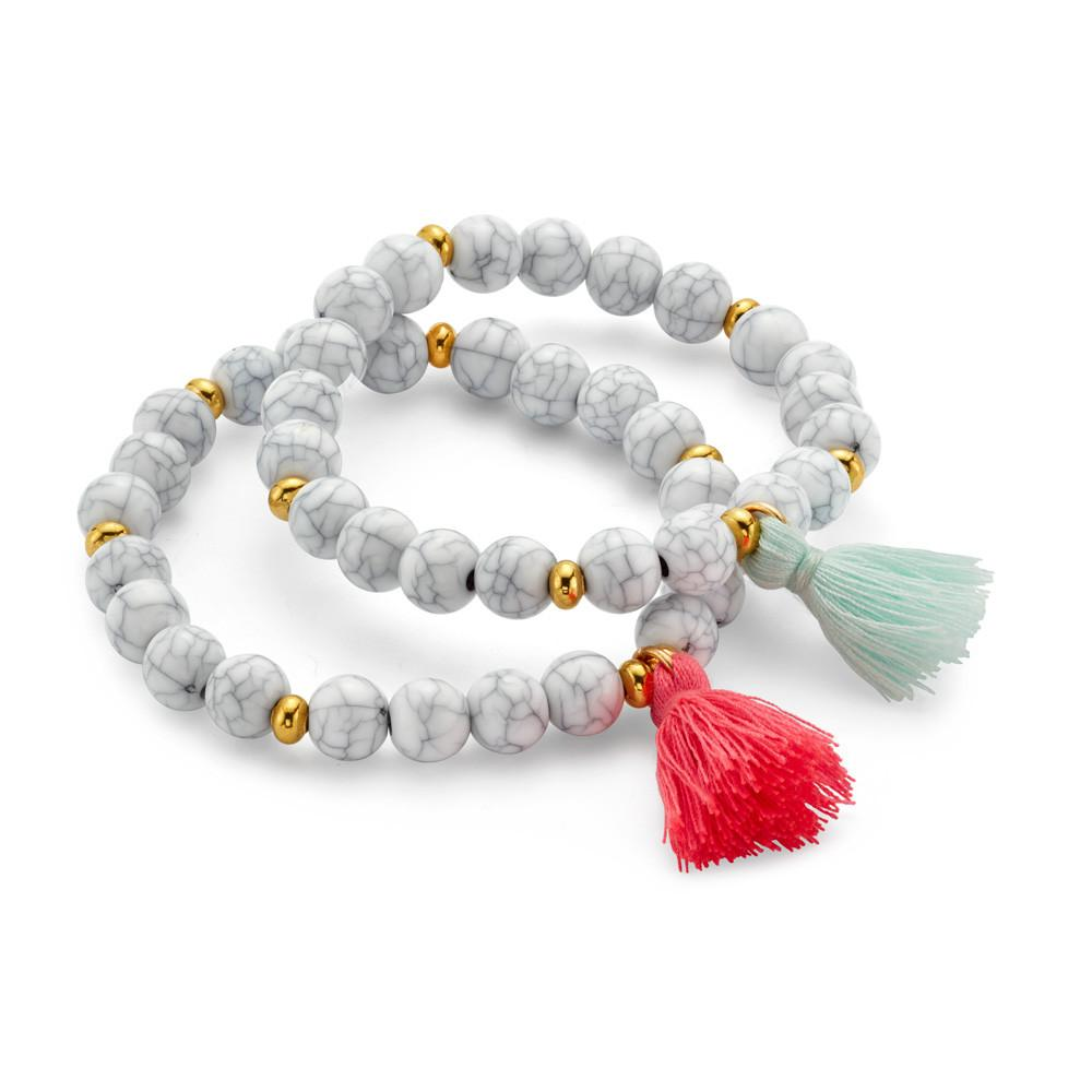 https://www.7charmingsisters.com/products/white-whispers-stackable-bracelet-with-tassel-pendant