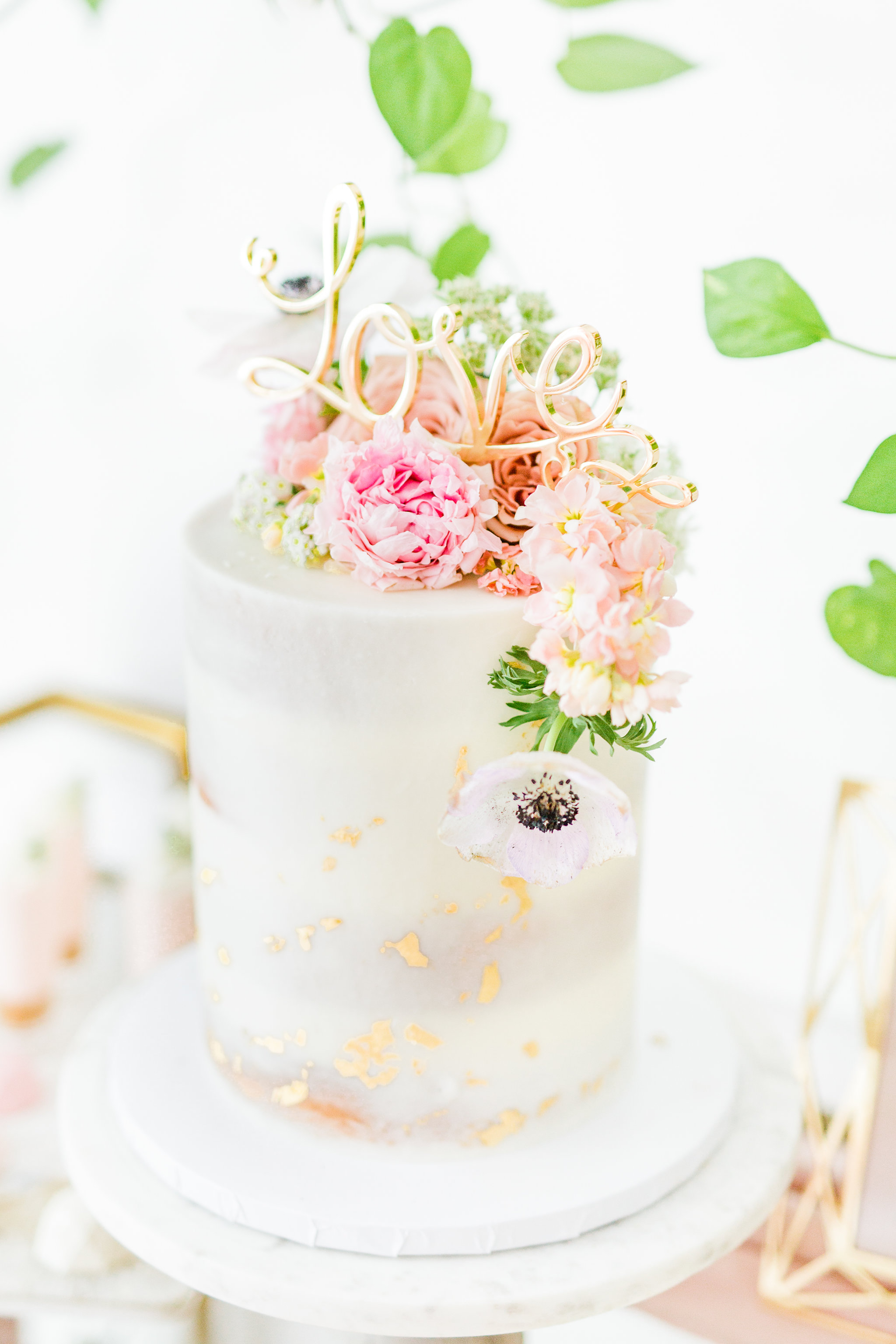 semi naked watercolor cake with edible gold detail peony marble cake stand
