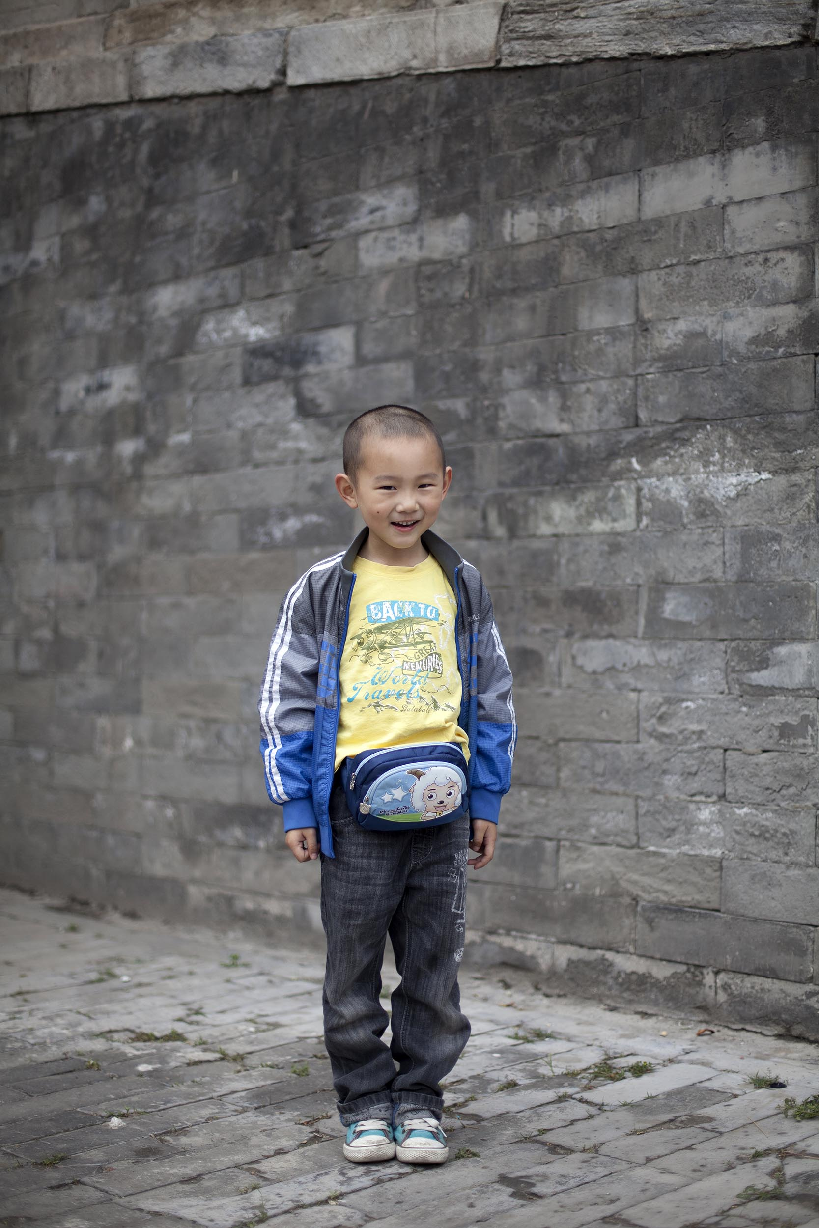 A portrait photograph of a young boy in the Forbidden City, Beijing , China  Documentary photography part of a personal project
