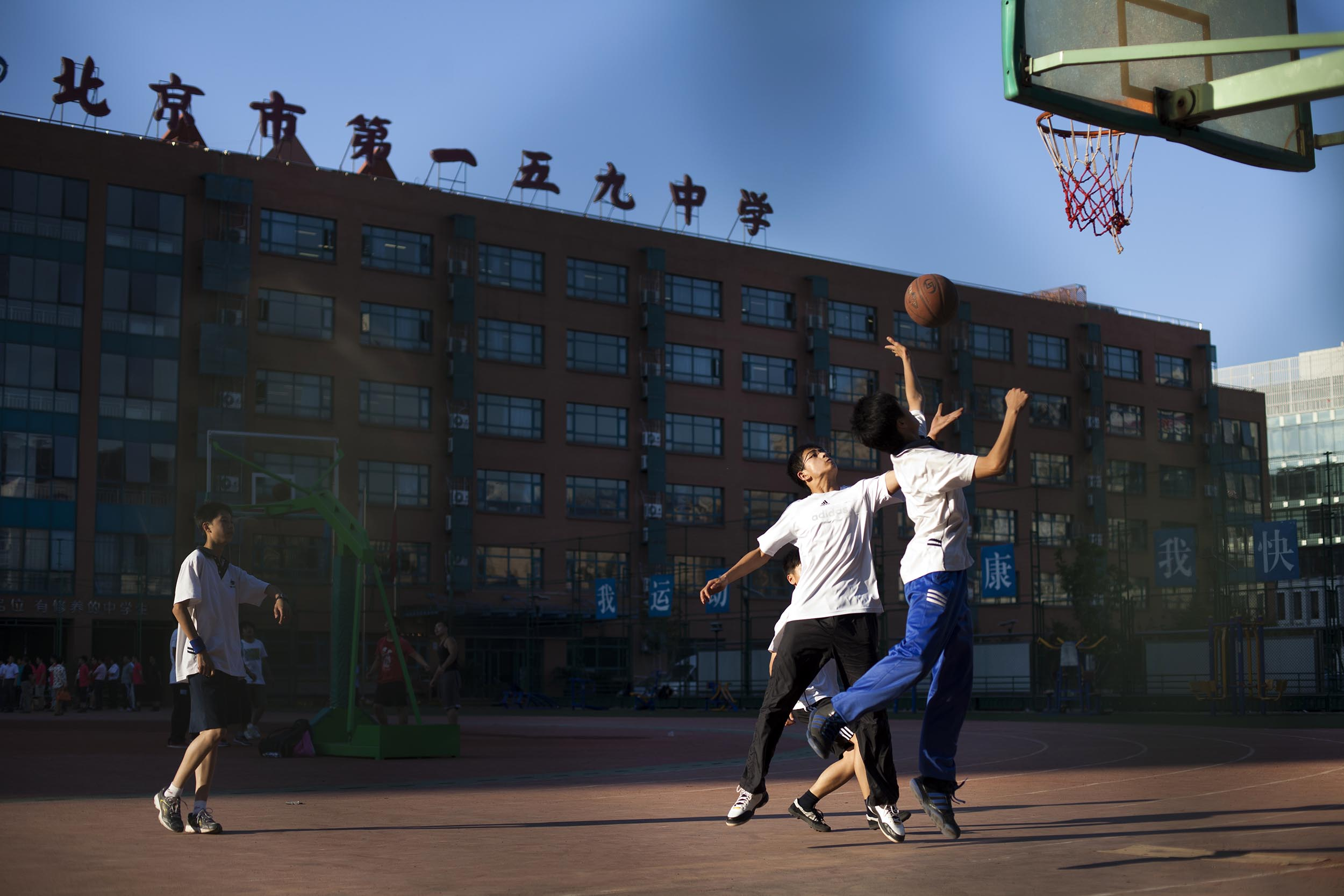 A photograph of young men playing basketball Shanghai, China  Photography for personal project