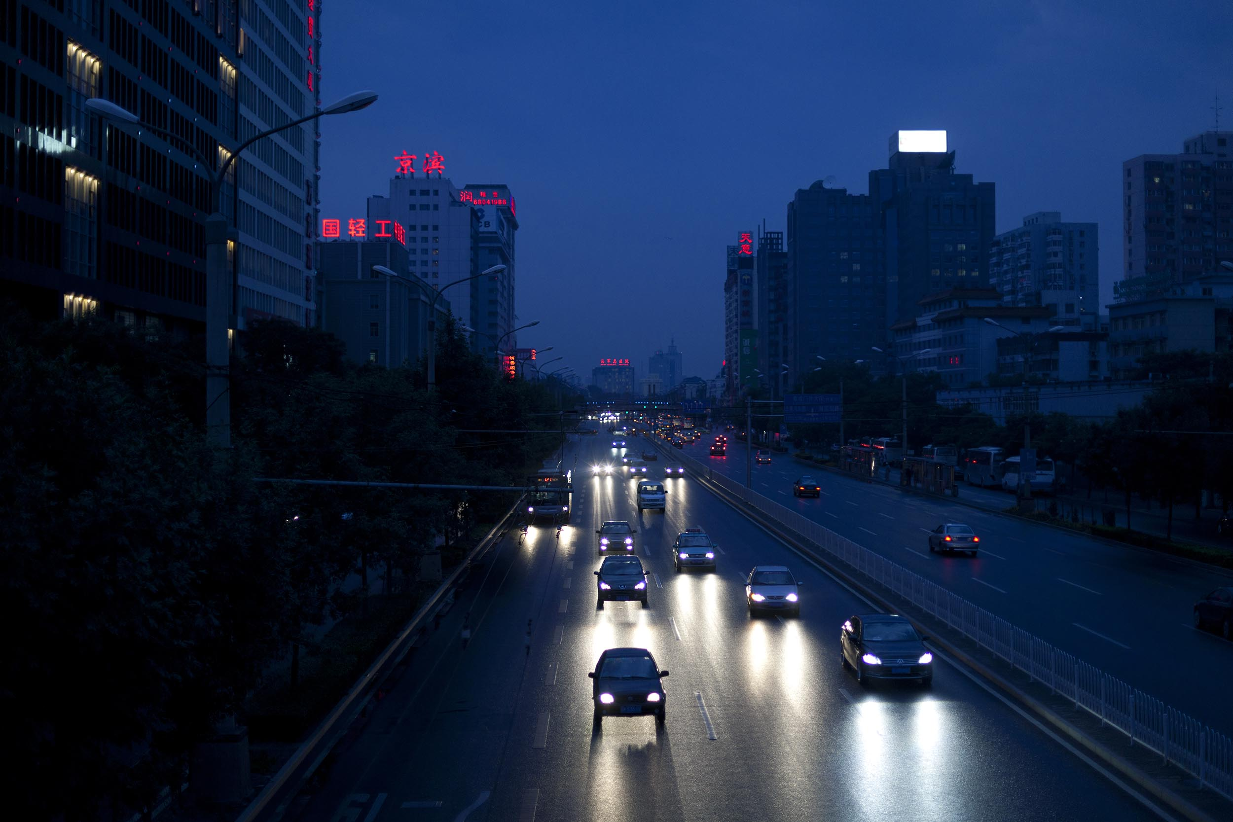 A photograph of a street in the rain at night Beijing, China  Photography for Beijing Government