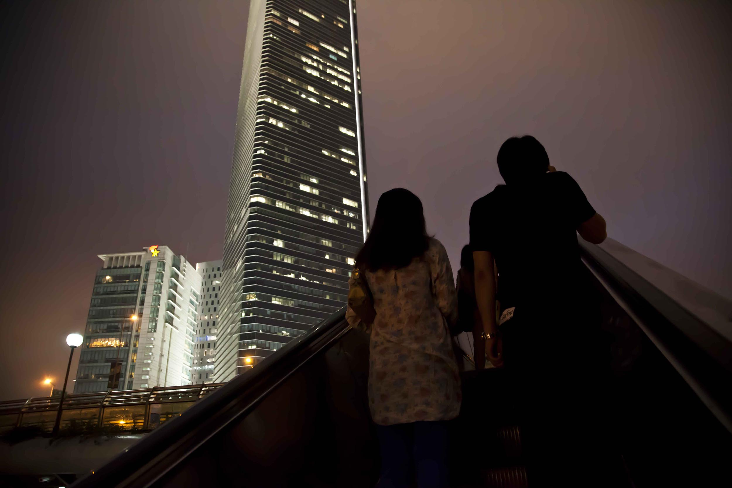A photograph of people on an escalator at night Shanghai, China  Photography for personal project