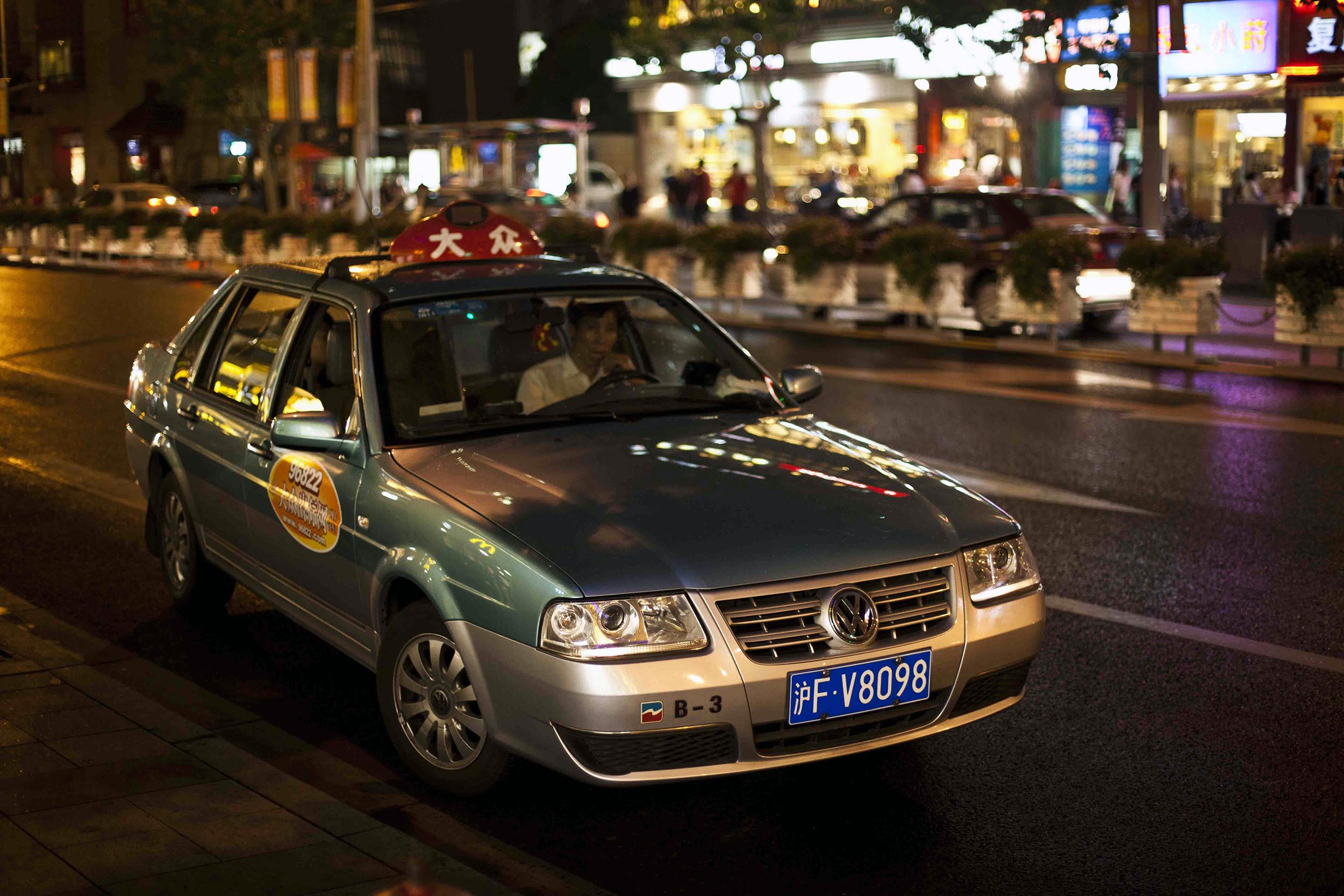 A photograph of a taxi at night Shanghai, China  Photography for personal project