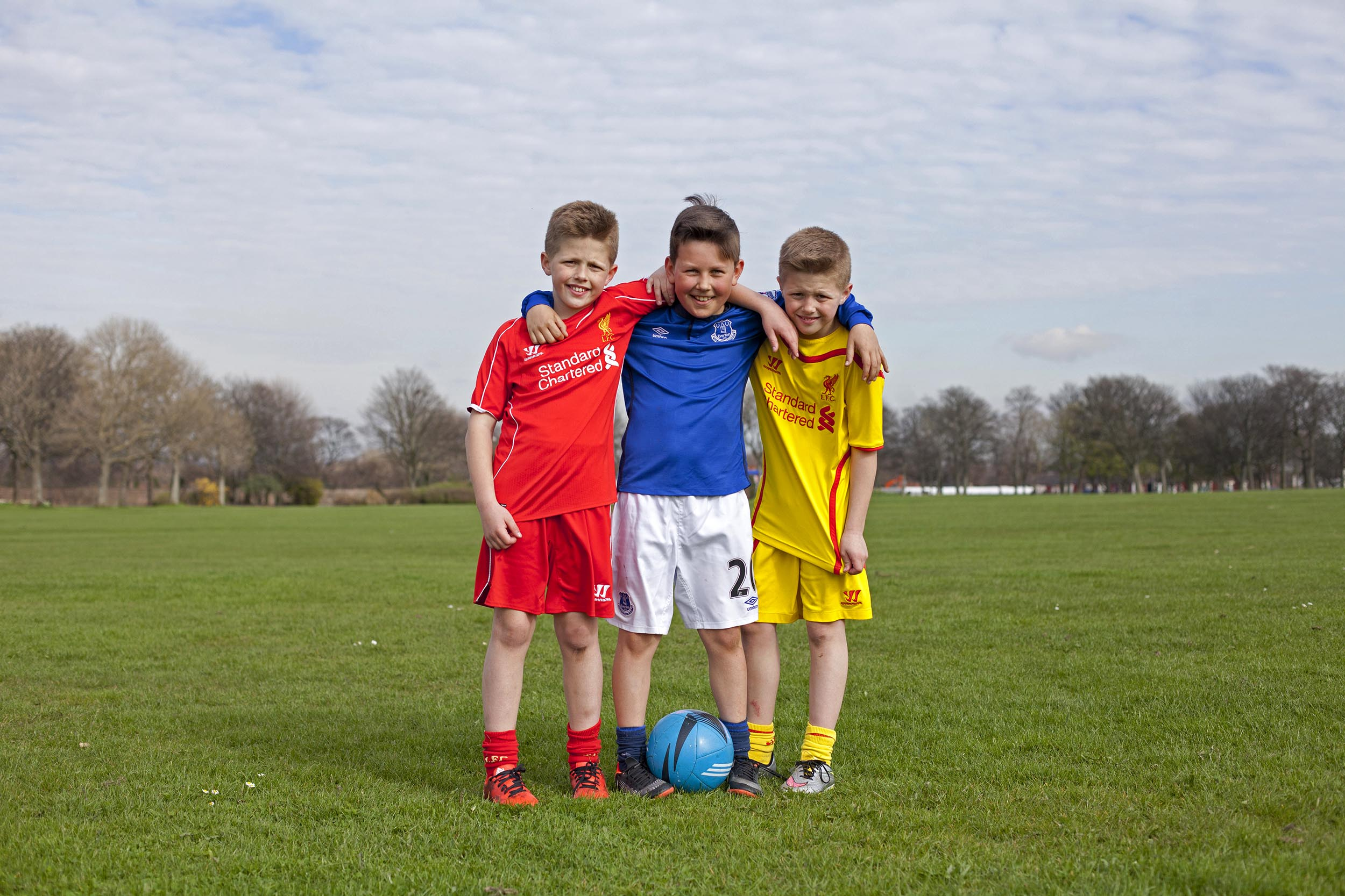 Young boys, Liverpool and Everton fans in Stanley Park, Liverpool - Documentary Photography