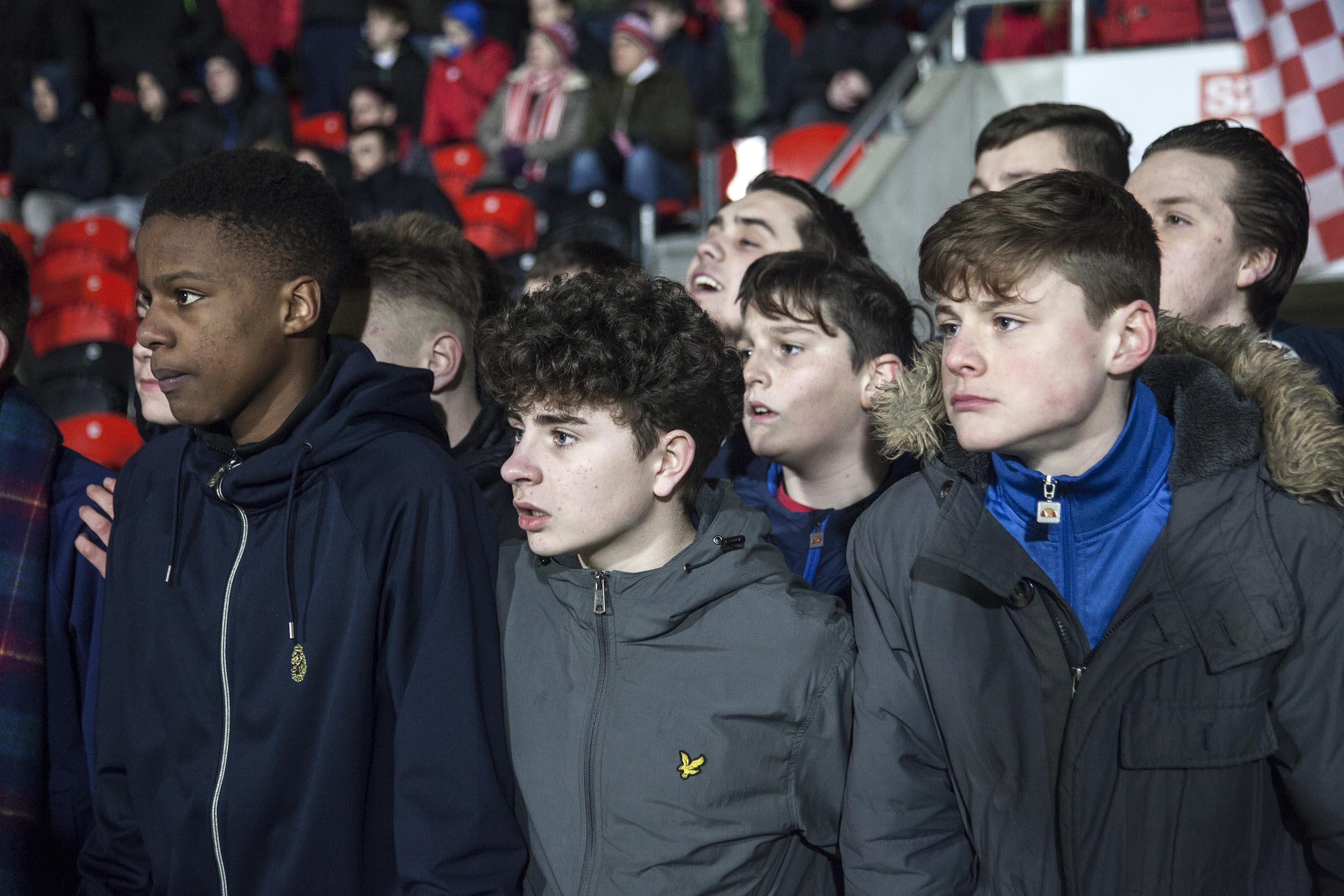 A documentary photograph of young fans at Doncaster Rovers' Keepmoat Stadium.  I was commissioned as documentary photographer by German football magazine 11 Freunde.