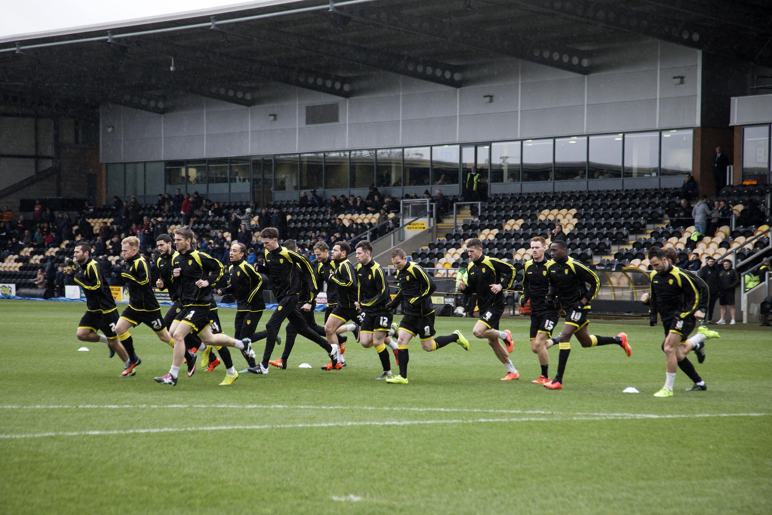A documentary photograph of players warming up at Burton Albion  I was commissioned as documentary photographer by German football magazine 11 Freunde.