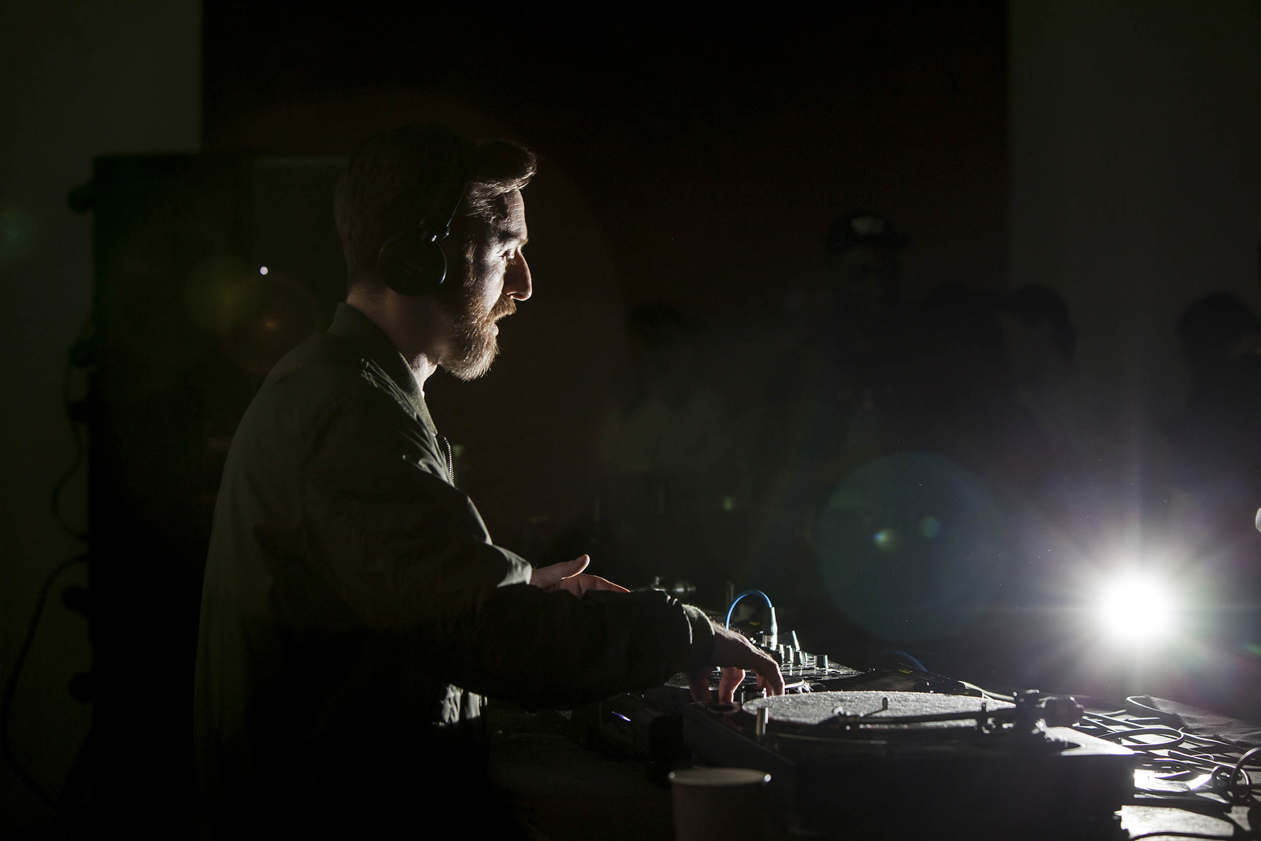 A documentary photograph of a DJ from NTS during an event at Whitworth Art gallery  Photography commissioned by Whitworth Art Gallery