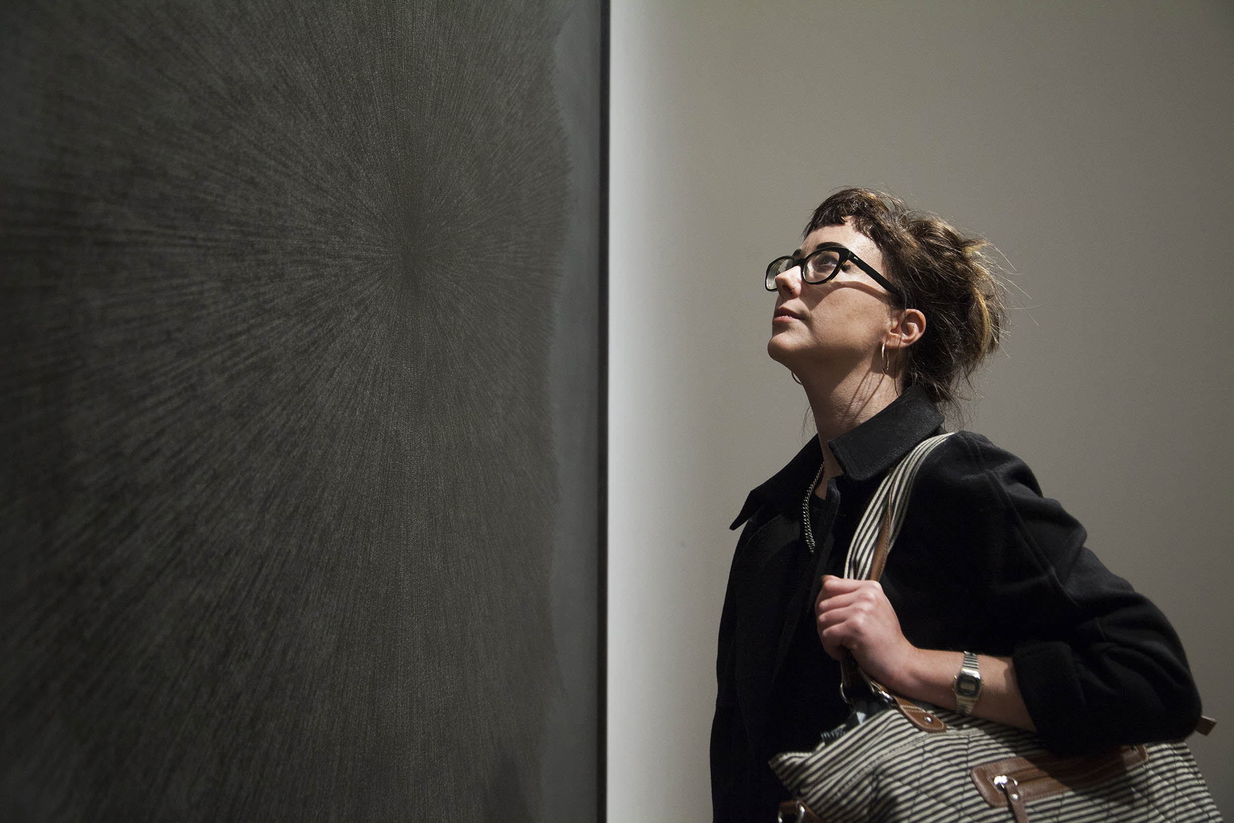 A documentary photograph of the public looking at artworks during an art opening.  Photography commissioned by Whitworth Art Gallery, Manchester