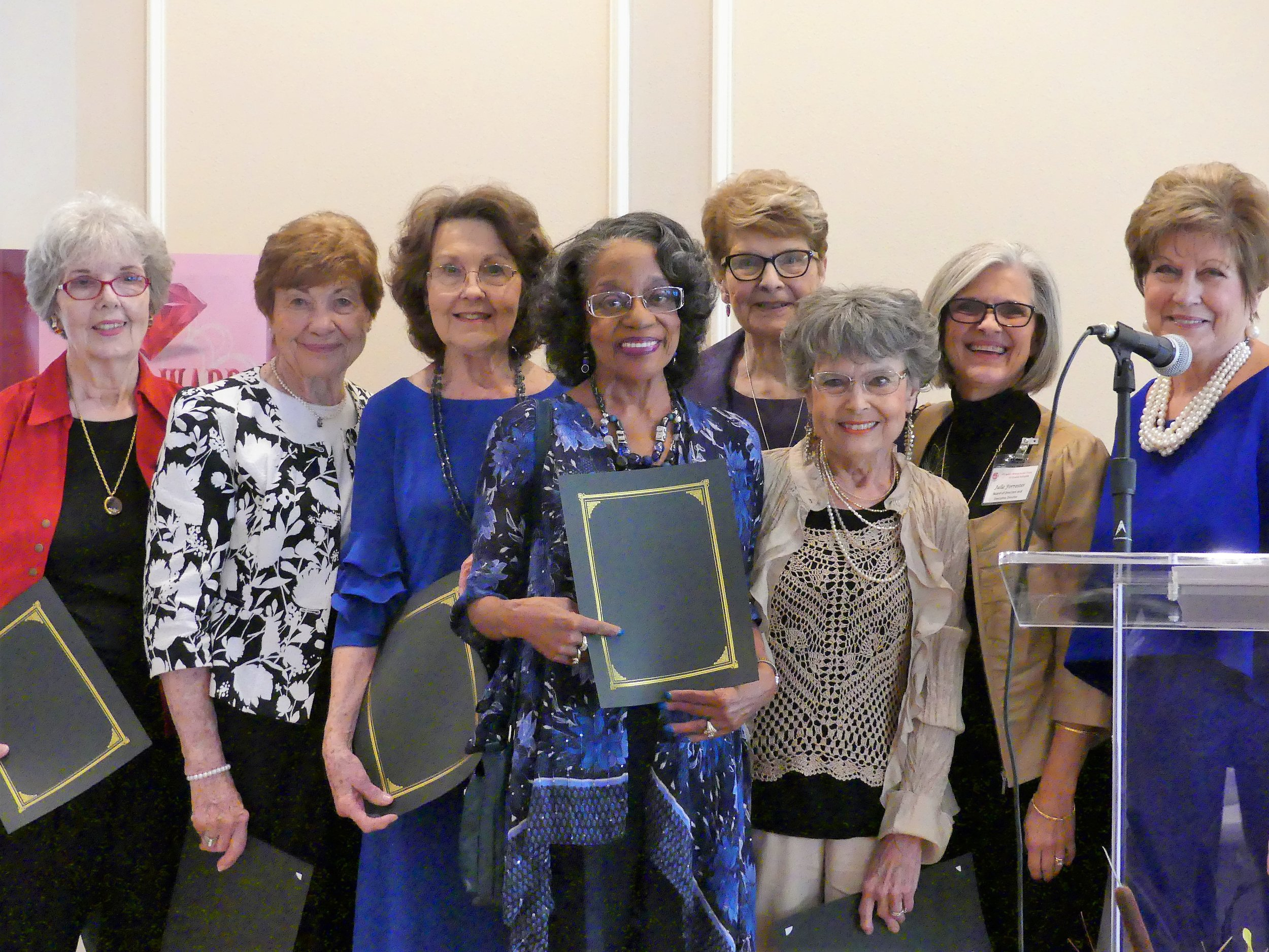 2017 Volunteer of the Year Award - Given in thanks to the CWJC Clothing Boutique Team. Sandra Lewis, Eloise Thorne, Carolyn Alexander, Jean Brown, and Sarah Mulkey pictured (Not pictured: Pat Barber), with Julie Forrester and Judy Duke.