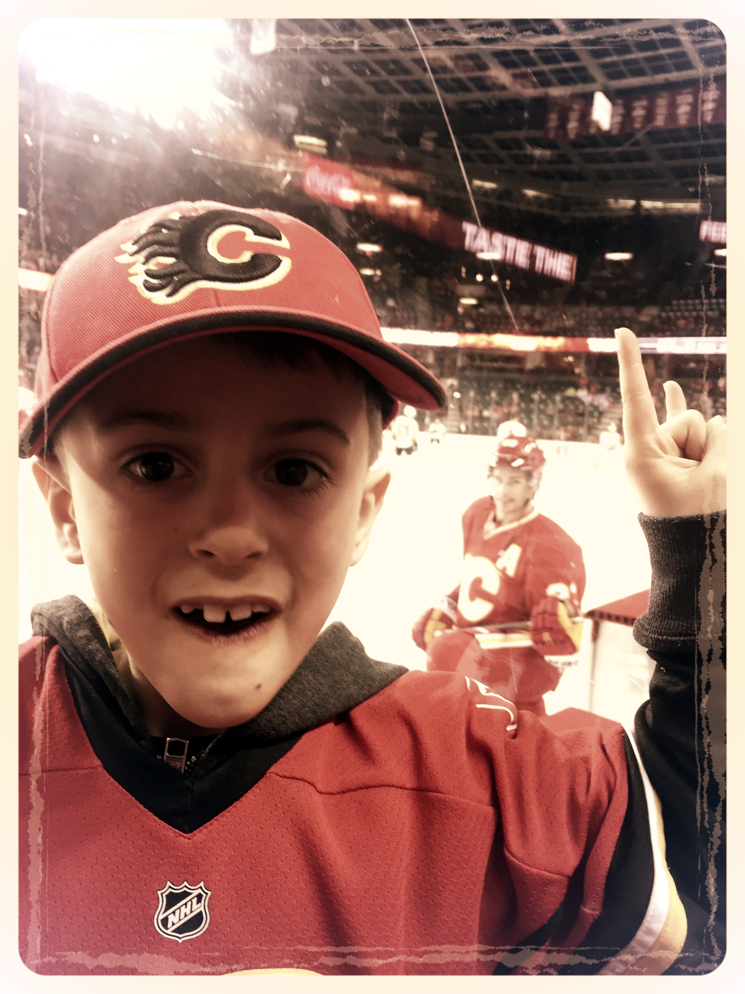 Ben at a Calgary Flames game with Sean Monohan in the background.