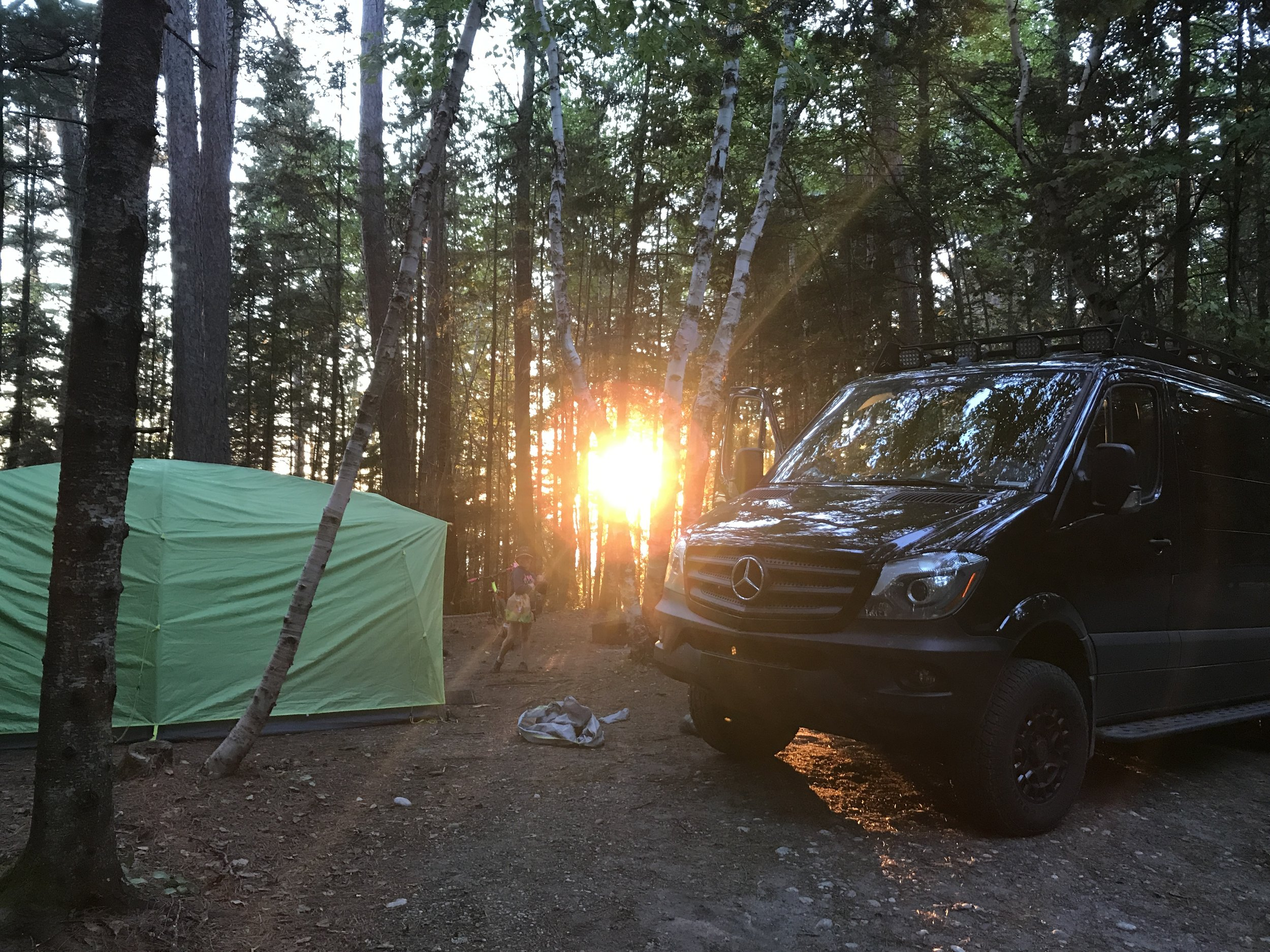 Campground at Lake Superior with a piercing sun.