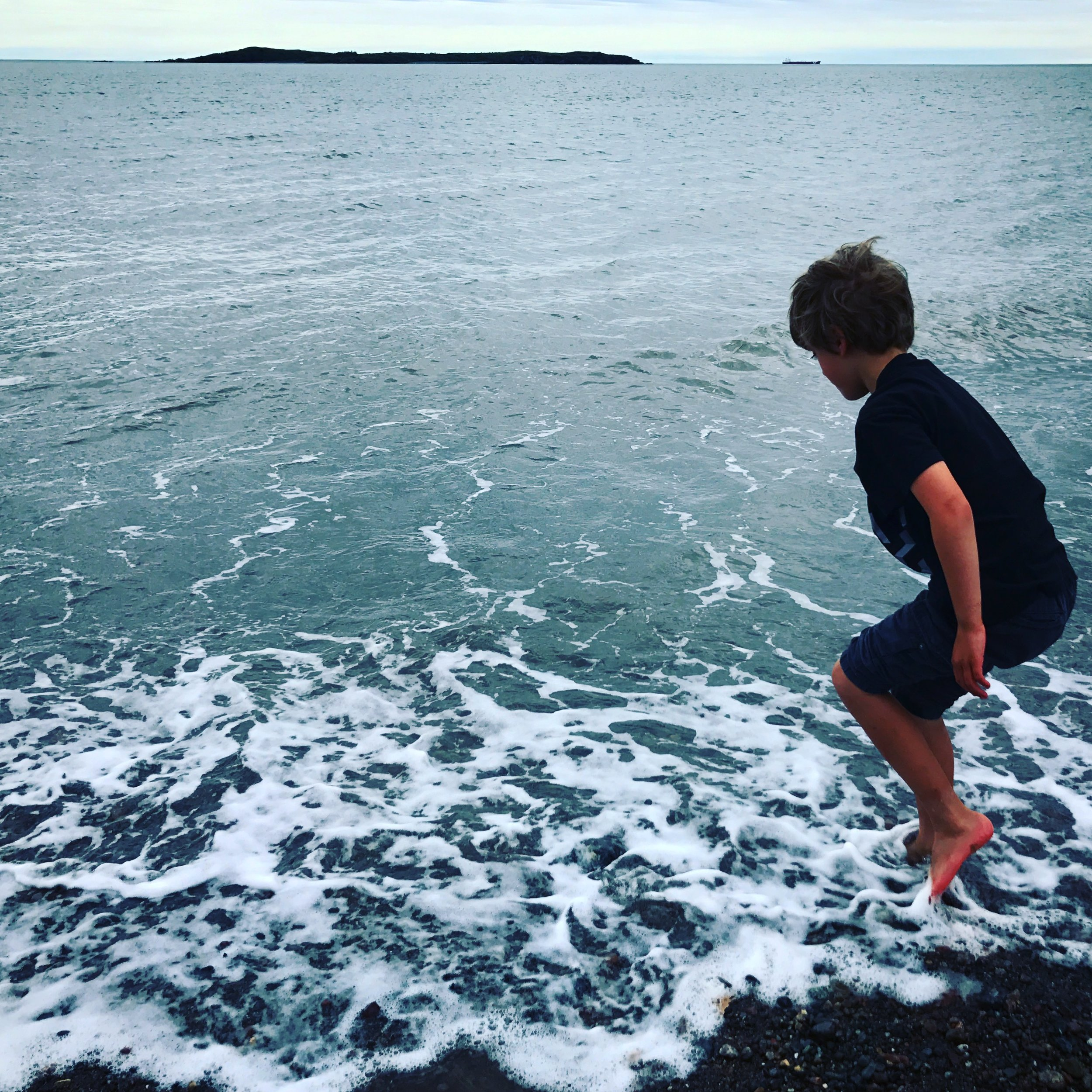 Ben trying to beat the tide at the Irving Nature Park in Saint John, New Brunswick.