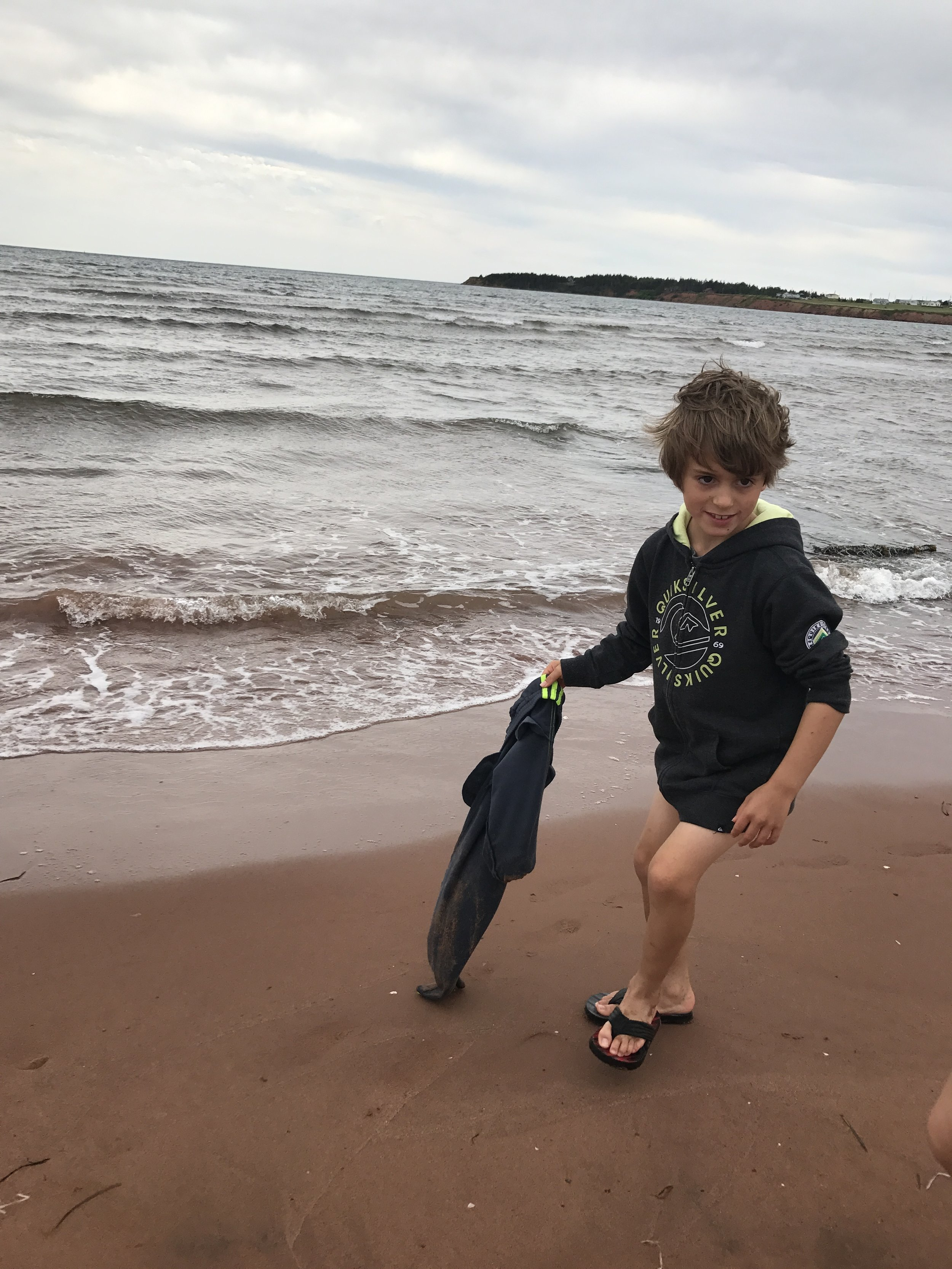 I just can't keep this kid dry...carrying his pants...can you guess why?