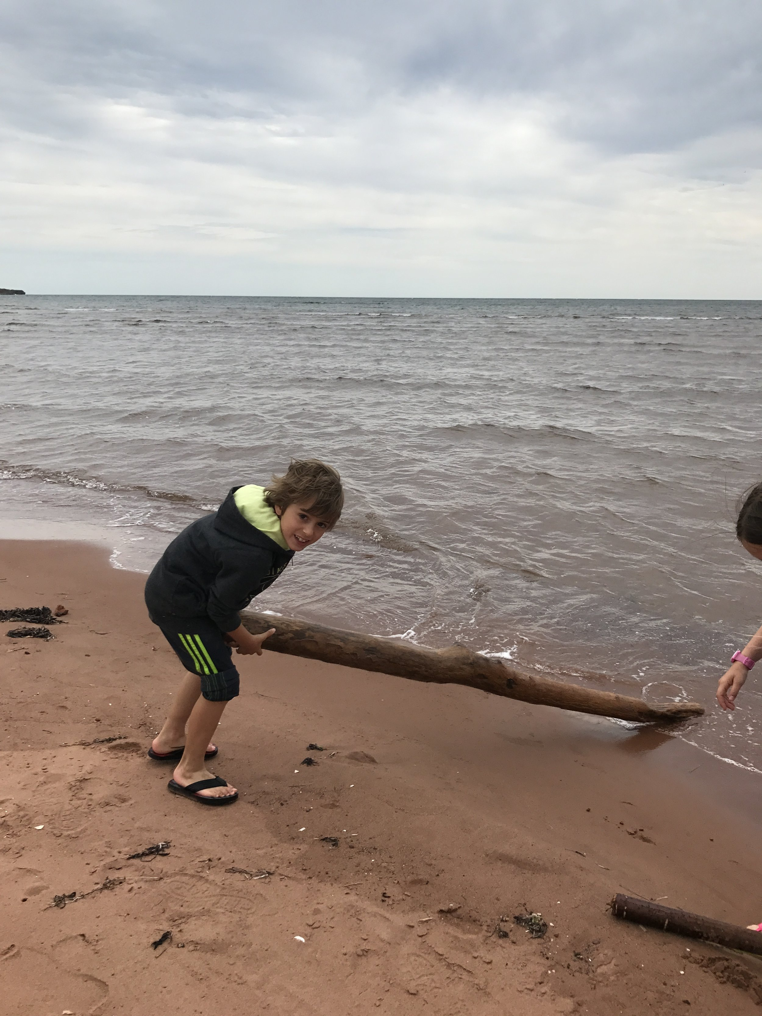 Boys will be boys...trying to float sticks, LOL!