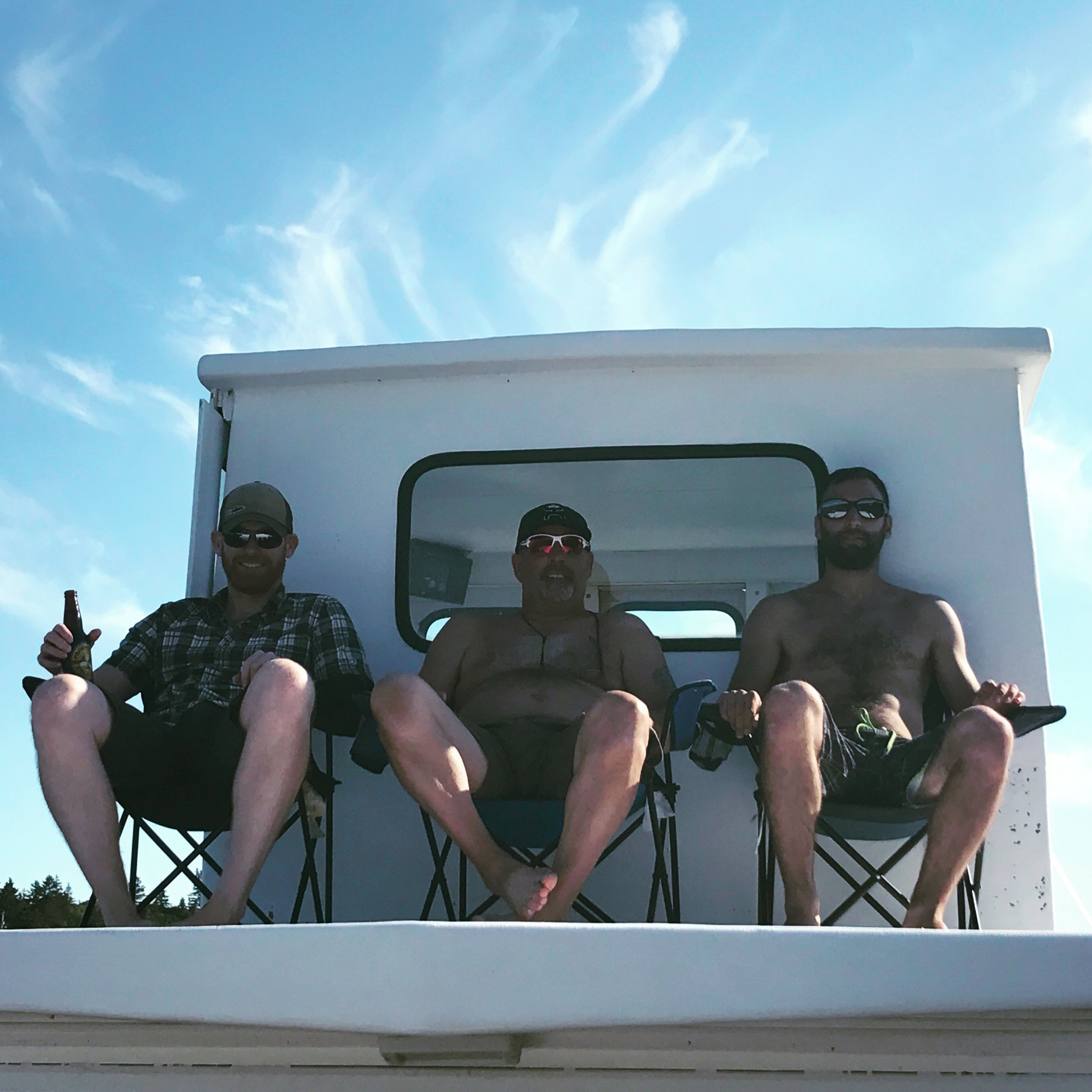 Enjoying a brew and a float with the homeboys...boatlife.