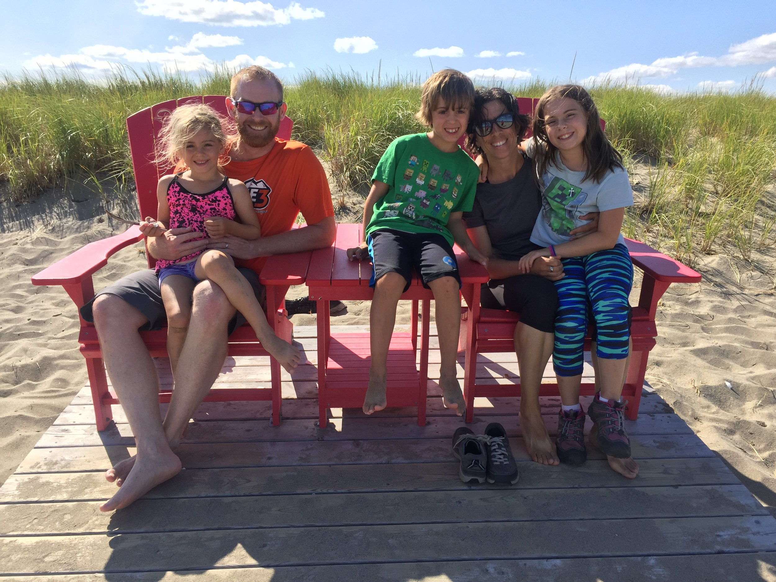 Family Photo on the red #sharethechairs on Kelly's Beach in Kouchibouguac.