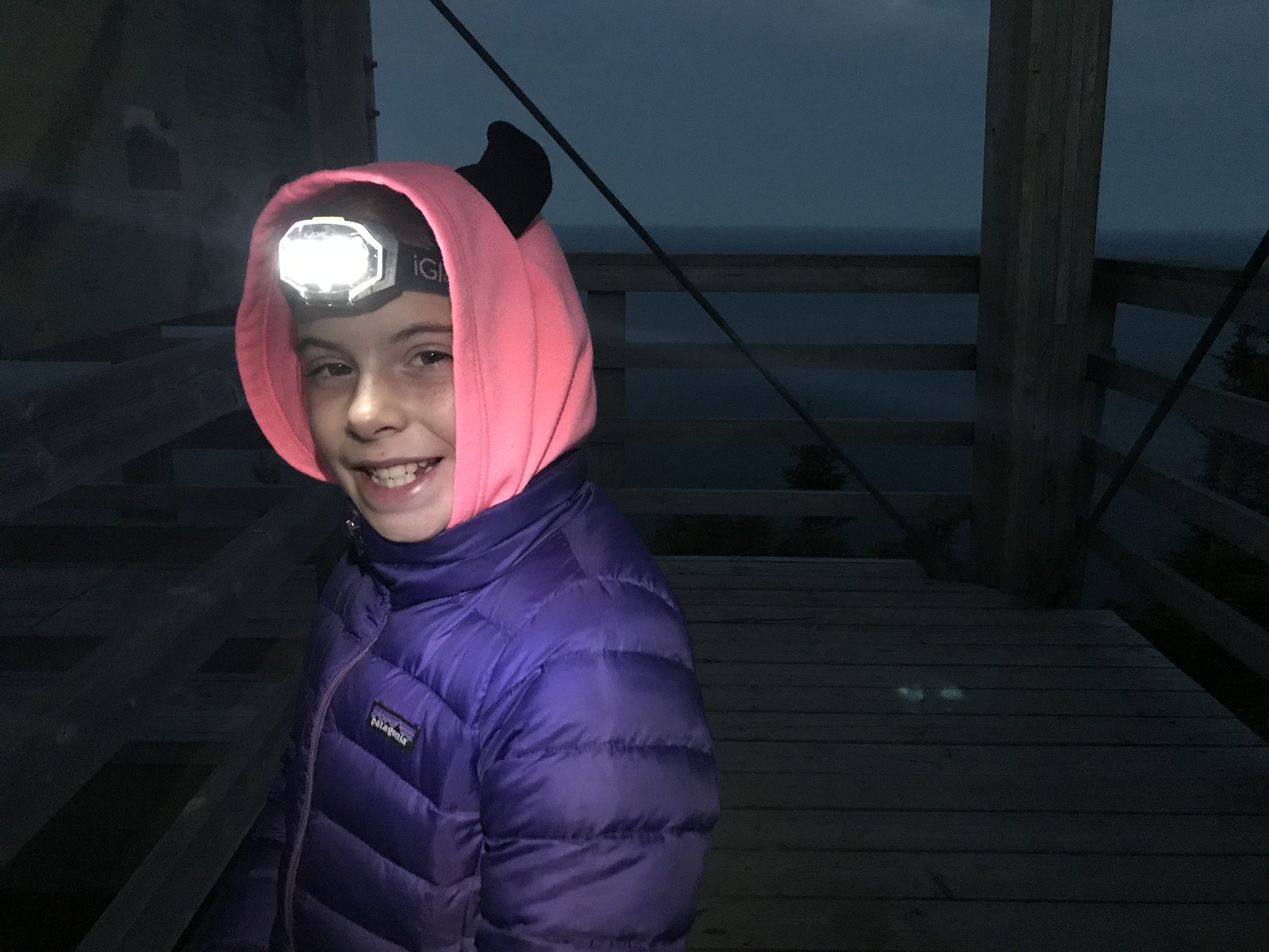 Sophie geared with her head lamp.