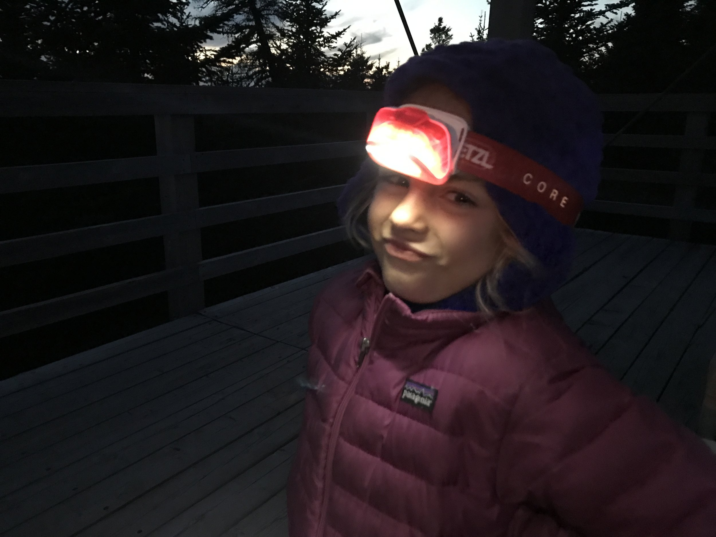 Ellie's not sure about hiking in the dark but she's ready to go. She had lots of fun playing with her shadow on the way down.
