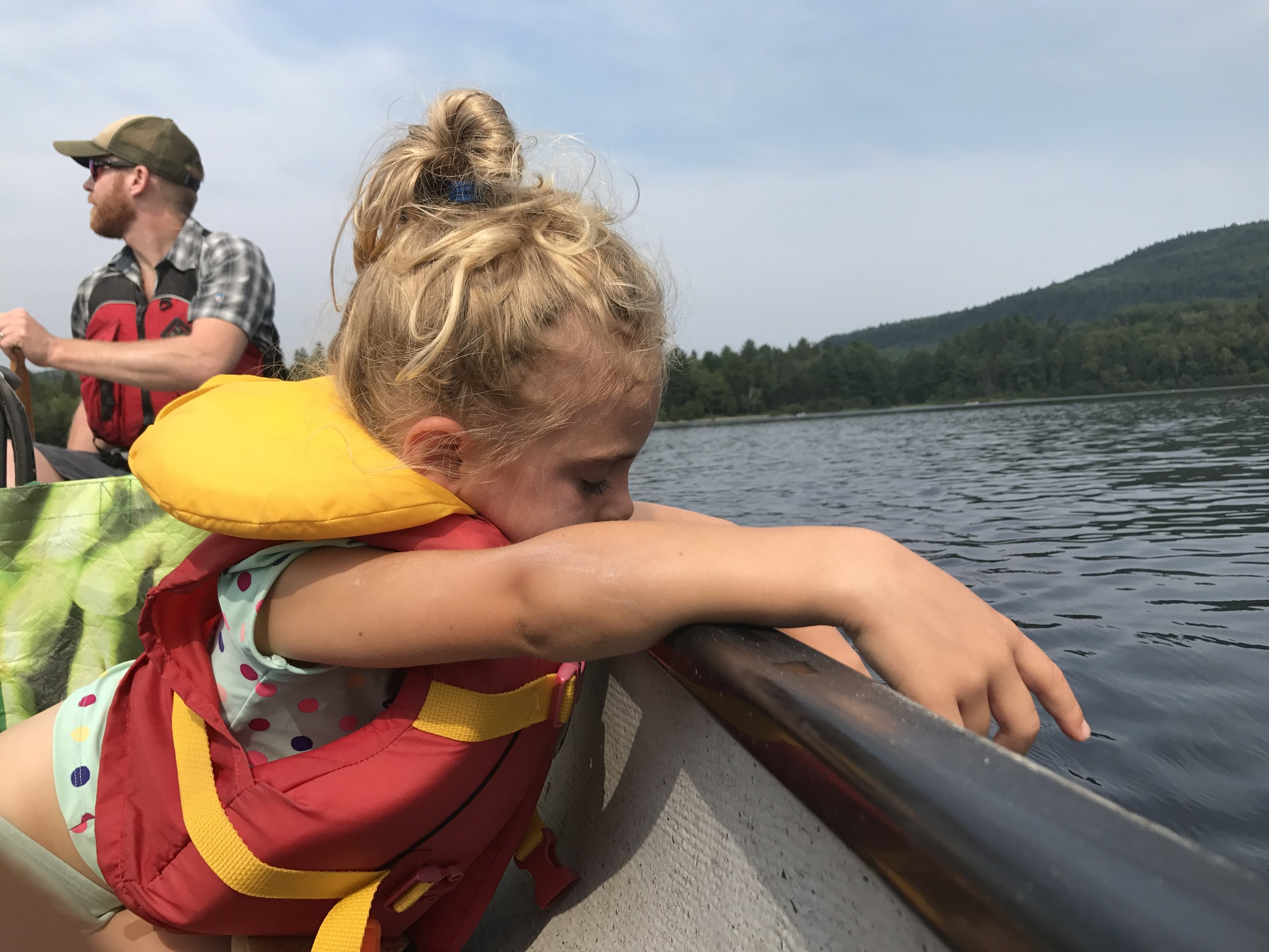 Feeling the water over the canoe's edge.