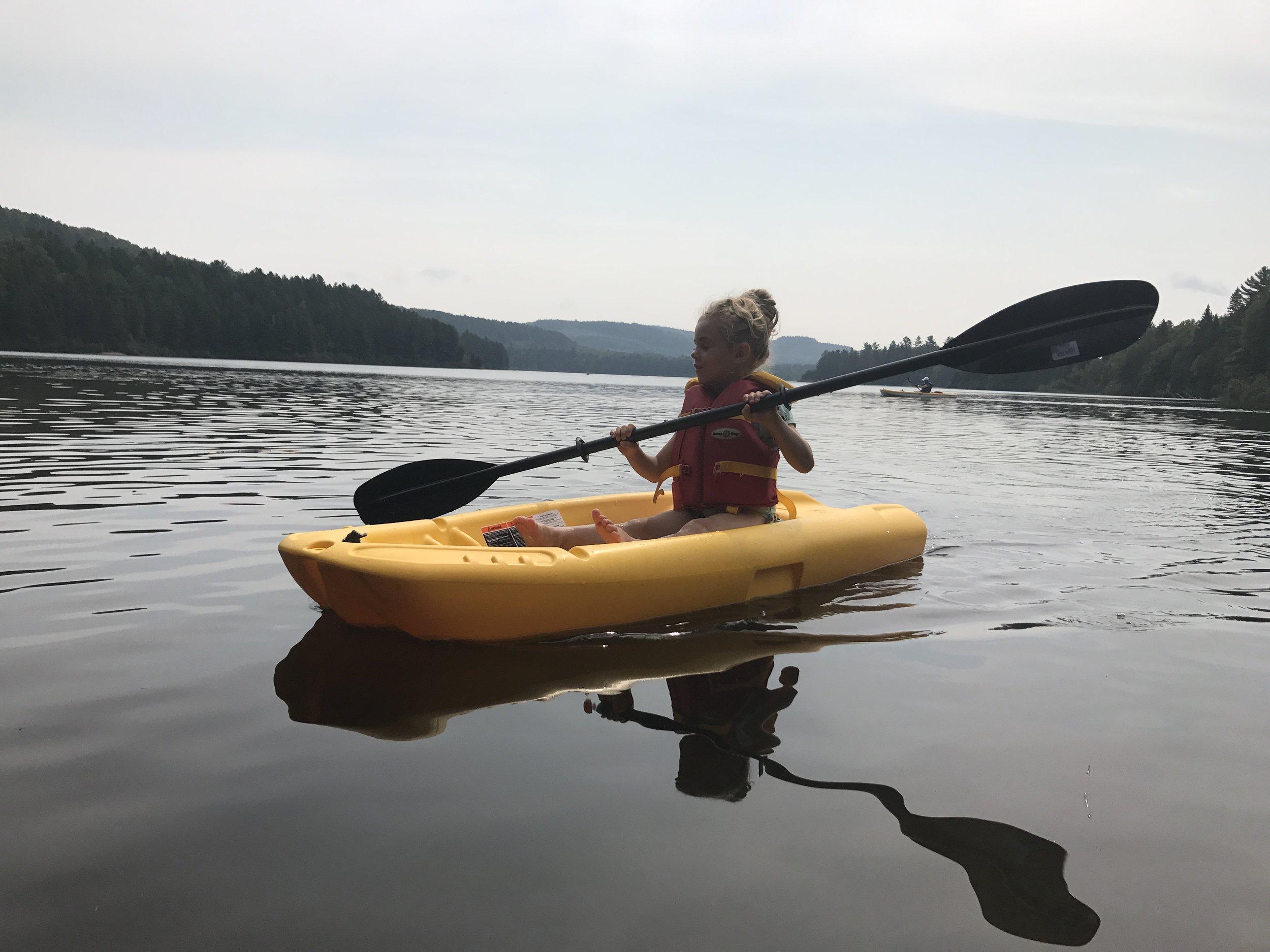Ellie paddles.