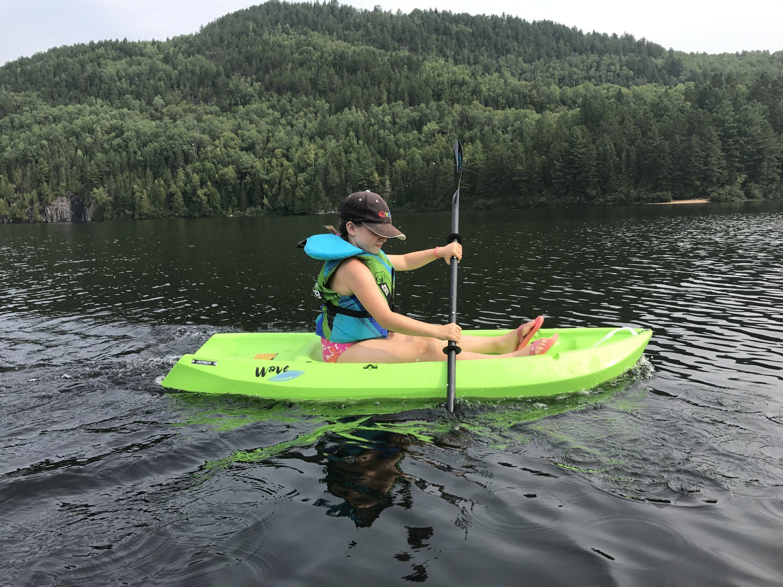 Sophie paddles.