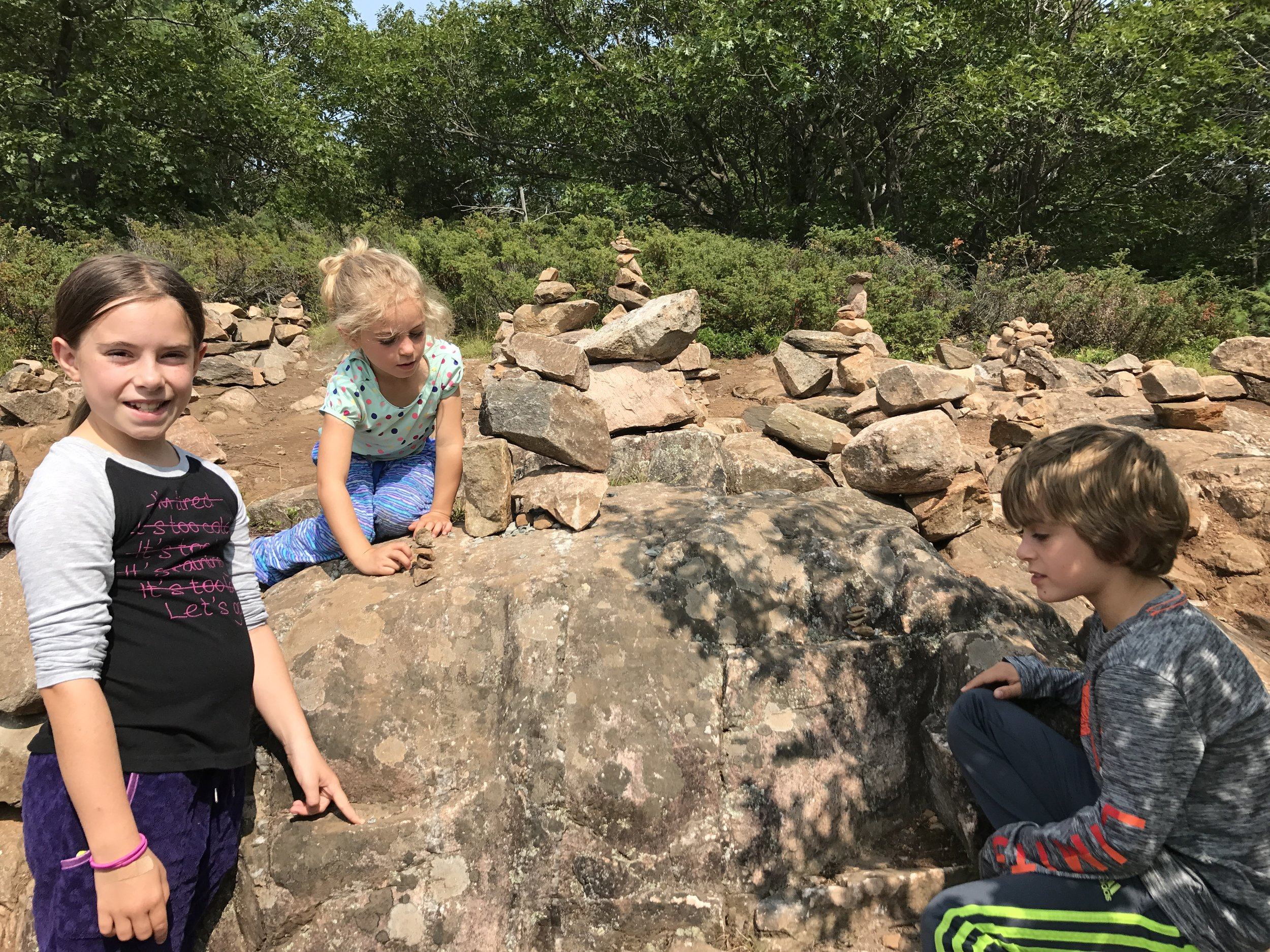 A family on Inusksuks on the Cliff Top Trail, Bon Echo Park.