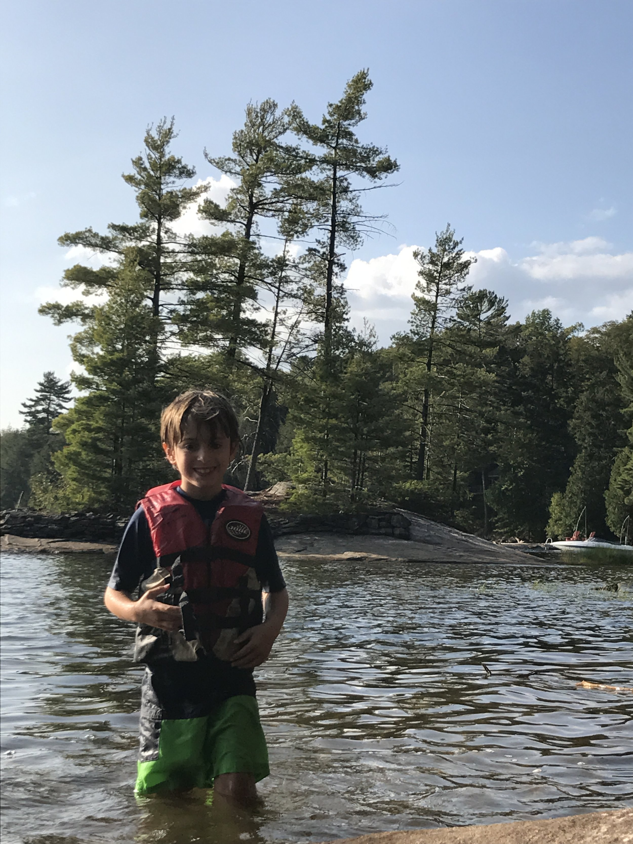 Ben is stoked after Karen brought him for a spin on her jet-ski. (Kennisis Lake)