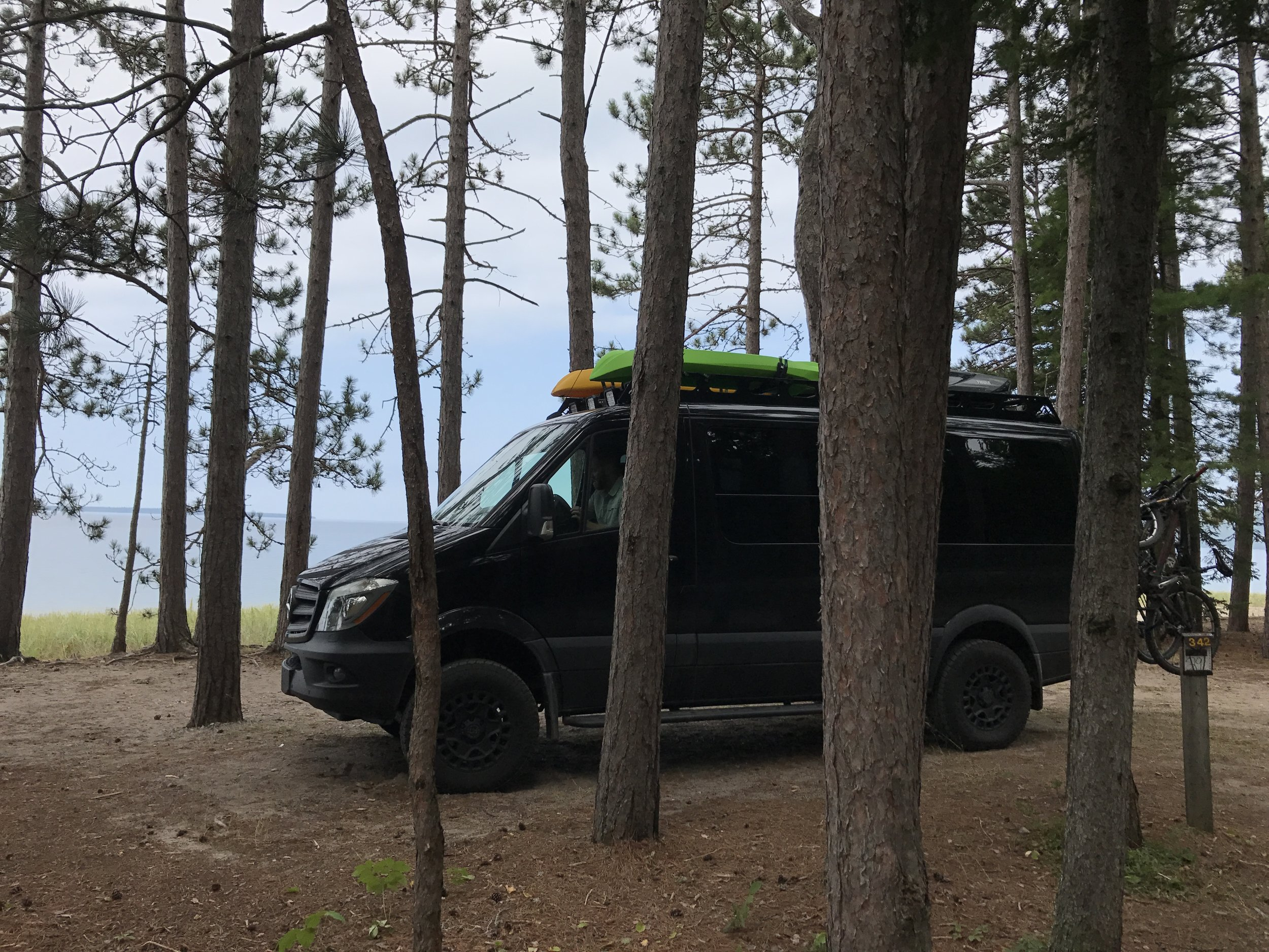 Black Betty threading the trees to park it for a few days on Lake Superior. Amazing site!