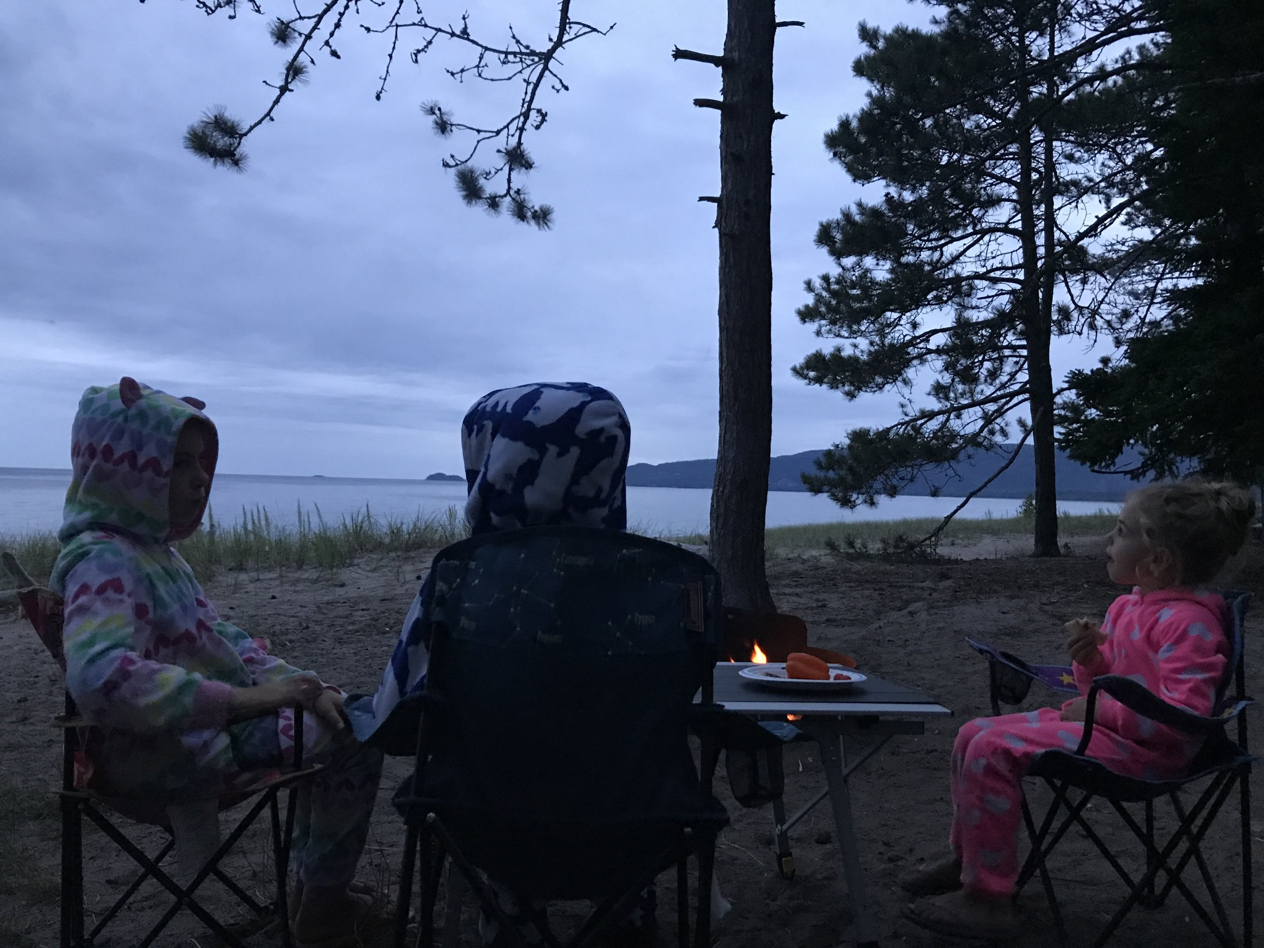 Late night snacks by a campfire on Lake Superior. All dressed and ready for bed.