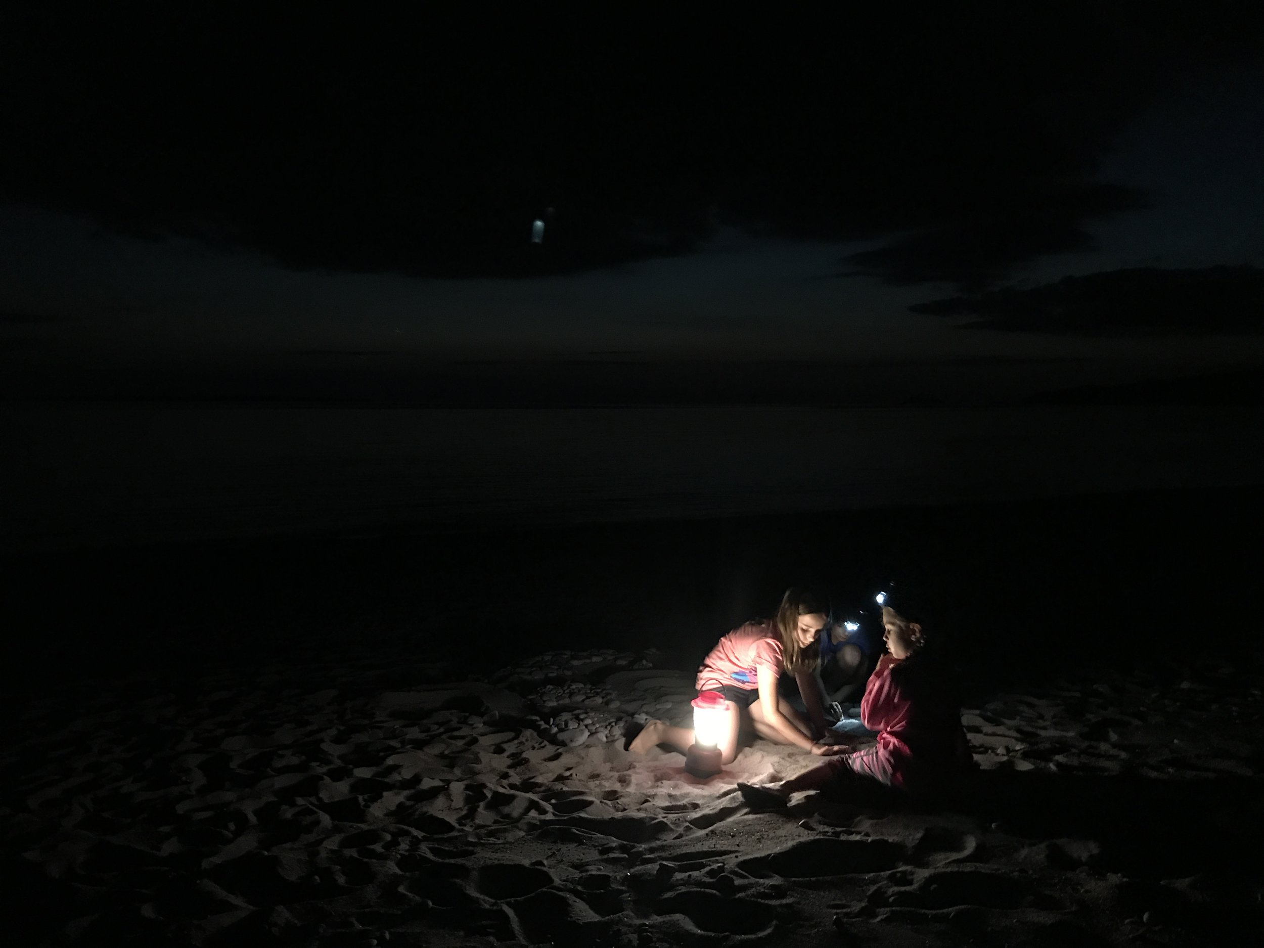 Playing in the sand with headlamps until the wee hours of the night.