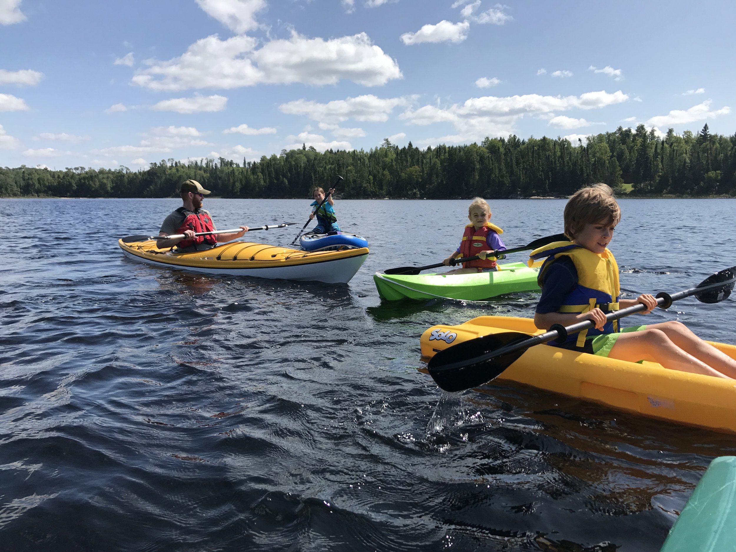 Family day on the waters of Quetico.