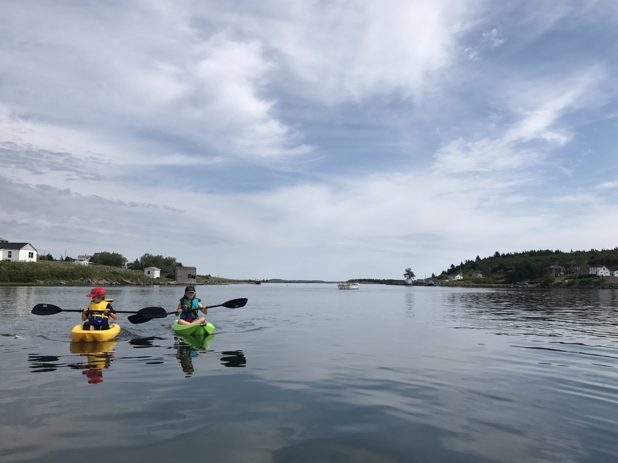 Paddling in the Petit de Grat harbor, Nova Scotia.