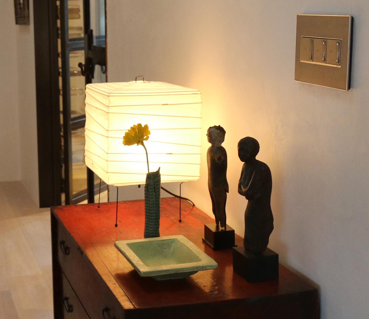 Akari table lamp vignette - Legrand Adorne wall dimmer